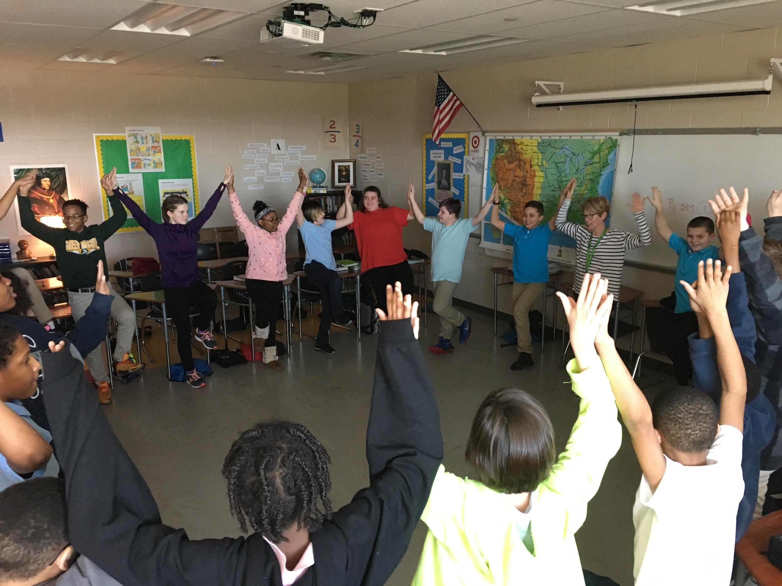Mrs. Blumberg's World History Class taking a break with some Yoga