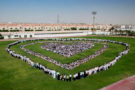 ASD -  Show of Compassion  - May 31, 2011  (teachers and parents of the American School of Doha encircle students in a moment of silence for the lives lost and those who lost loved ones in the May 28, 2012 fire)