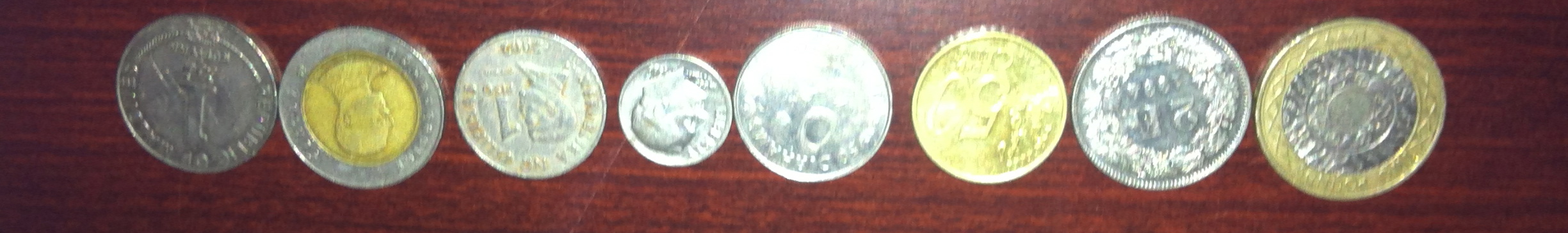 Just an example of Kiddo's piggy bank stash:    1 Rufiyaa Maldives, 10 Thai Baht, 1 Philippines Peso, 1 American dime, 50 Dirhams (Qatari), 50 Cent Euro, 2 Swiss Francs, 2 British pounds