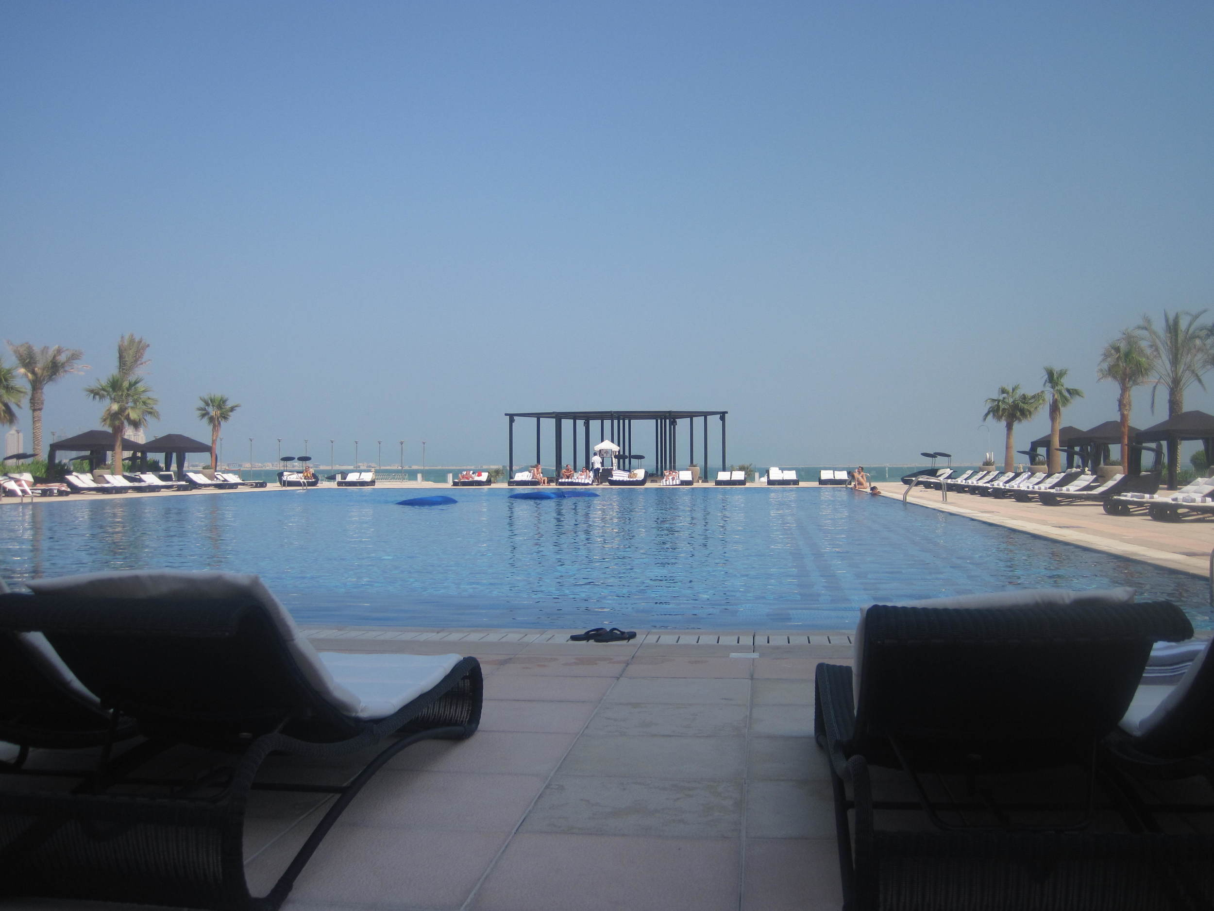Chillaxin' by the pool at St. Regis Hotel, Doha