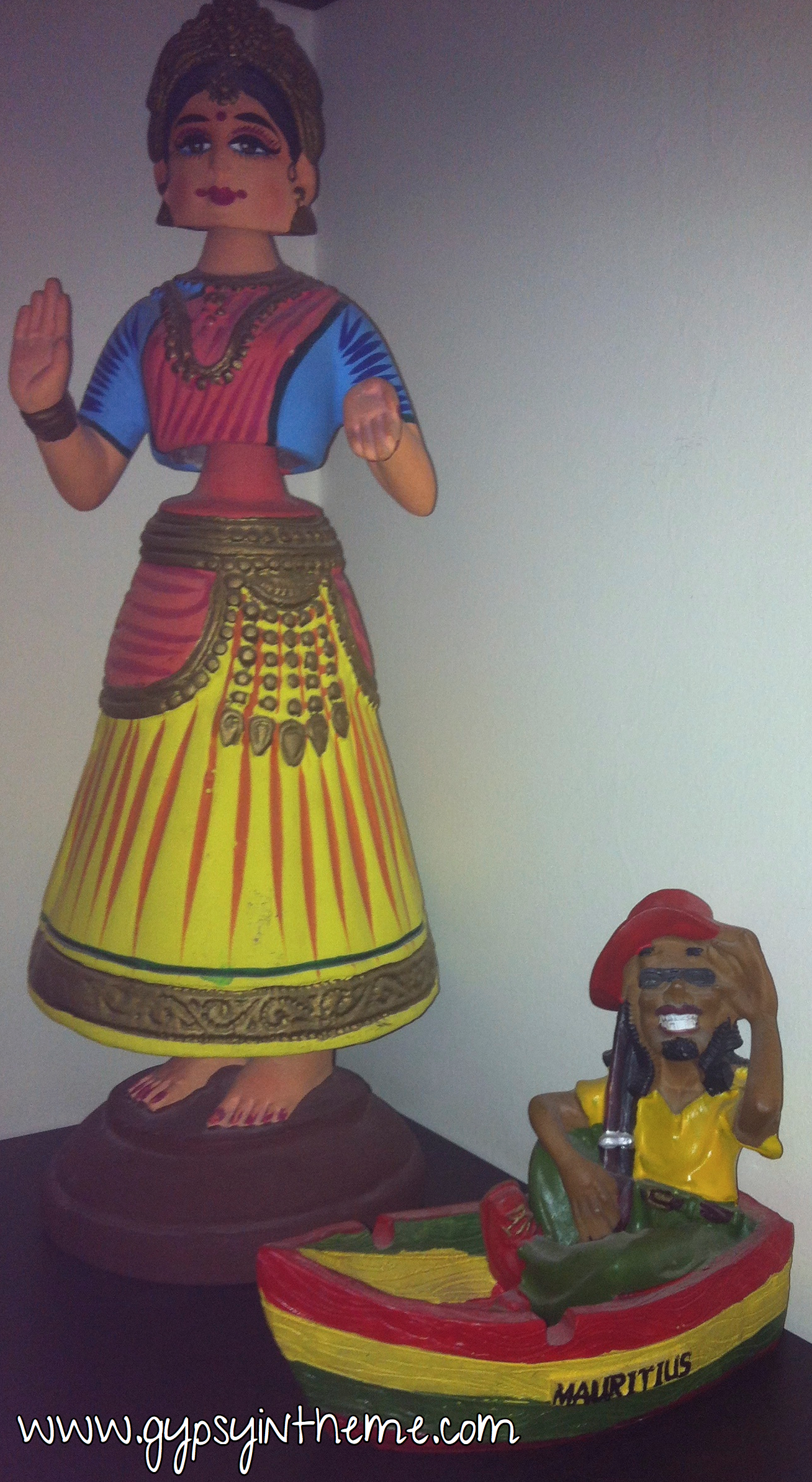 Mauritius Man and Bobble Babe.  Perhaps our tackiest yet best conversation pieces ever.  The latter was a gift from a friend from Mumbai; you tap on her skirt and her hips, torso and head bobble.  If you've lived in the Middle East, the bobble head movement is somewhat of an enigma, and alway a good conversation starter.  Mauritius man was a gift from our Ukranian/Dutch friends.  He just has people wondering whether he is holding a rifle or a super huge doob.  The jury's still out on that one.  Mauritius Man and Bobble Babe also hang out behind the bar.