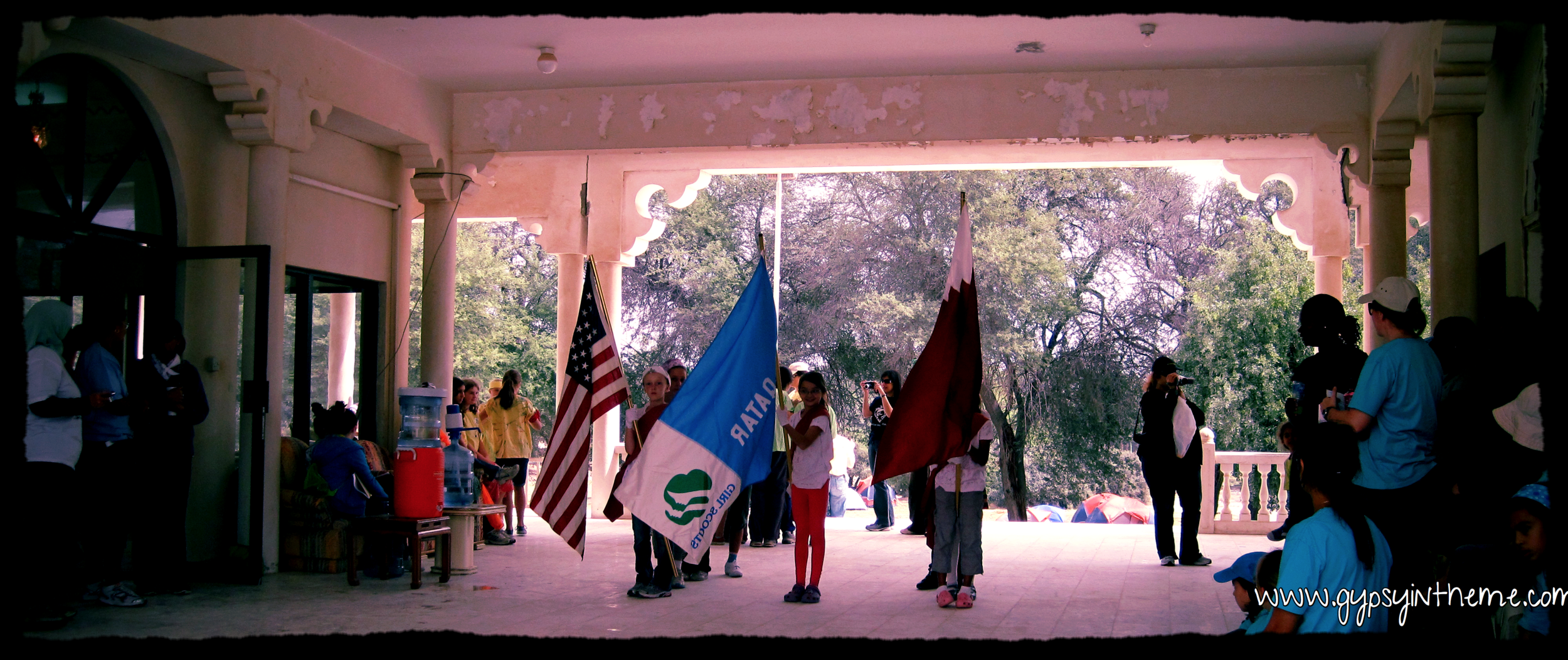 Girl Scout flag ceremony in Qatar. 2012 Camp Out on Sheik Faisal Museum grounds.