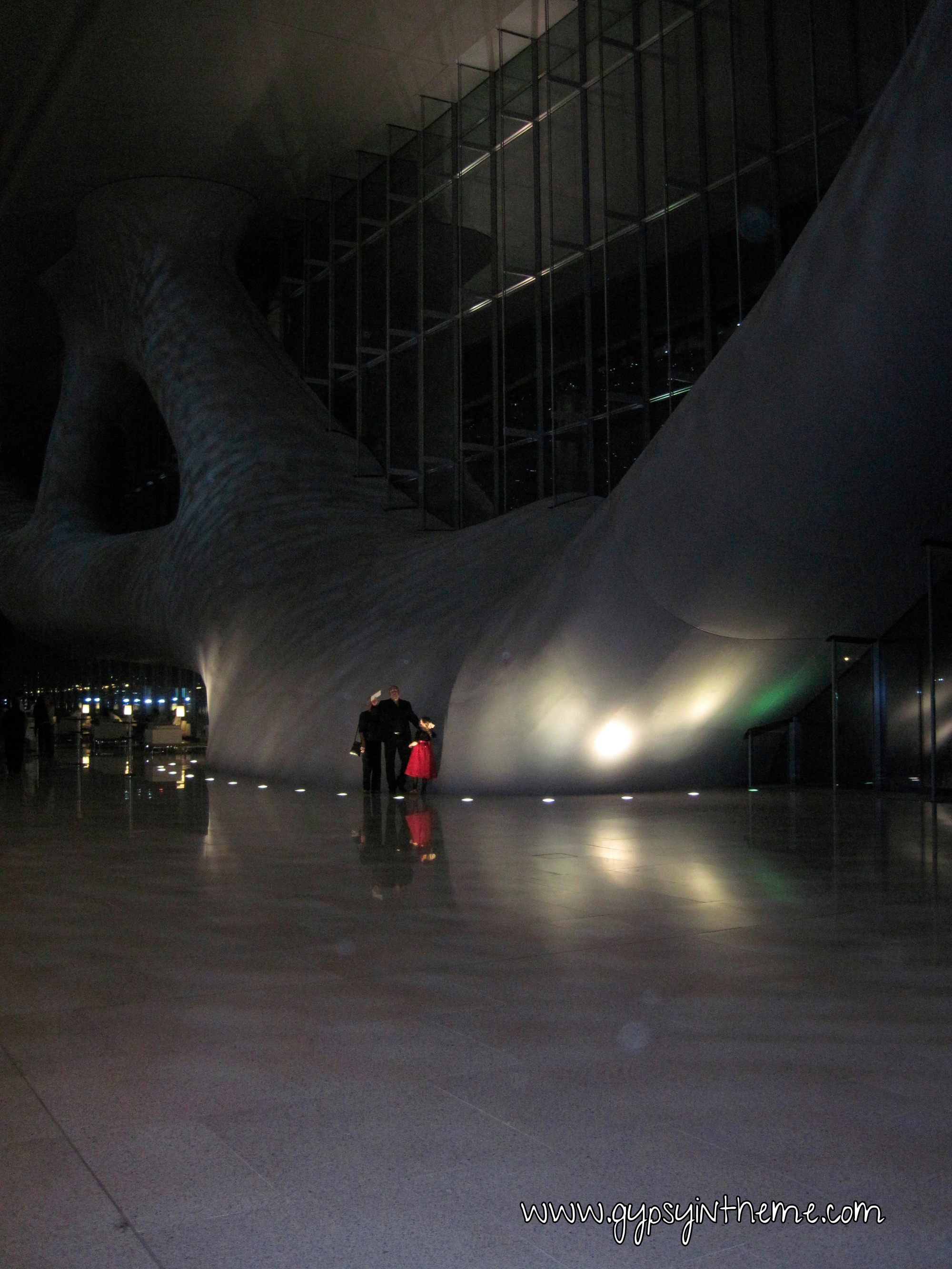 Inside the Qatar National Exhibition Center at night.