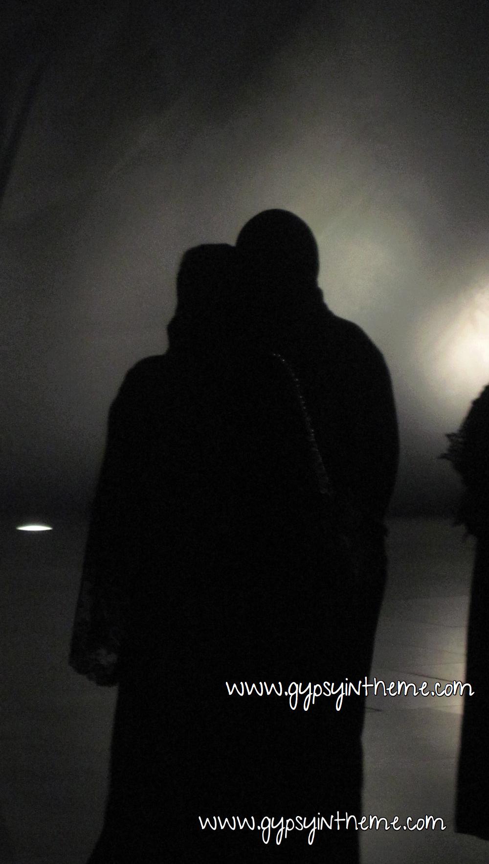 Abayas at night.