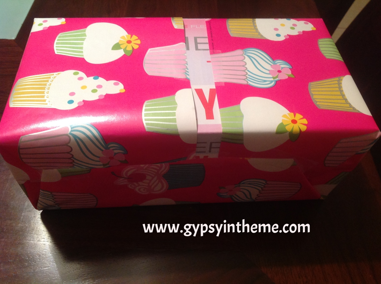 Yes, that is a Sketcher's shoe box peeking out where I ran out of paper.  But in my mind, the box colours complement the wrapping paper quite nicely.