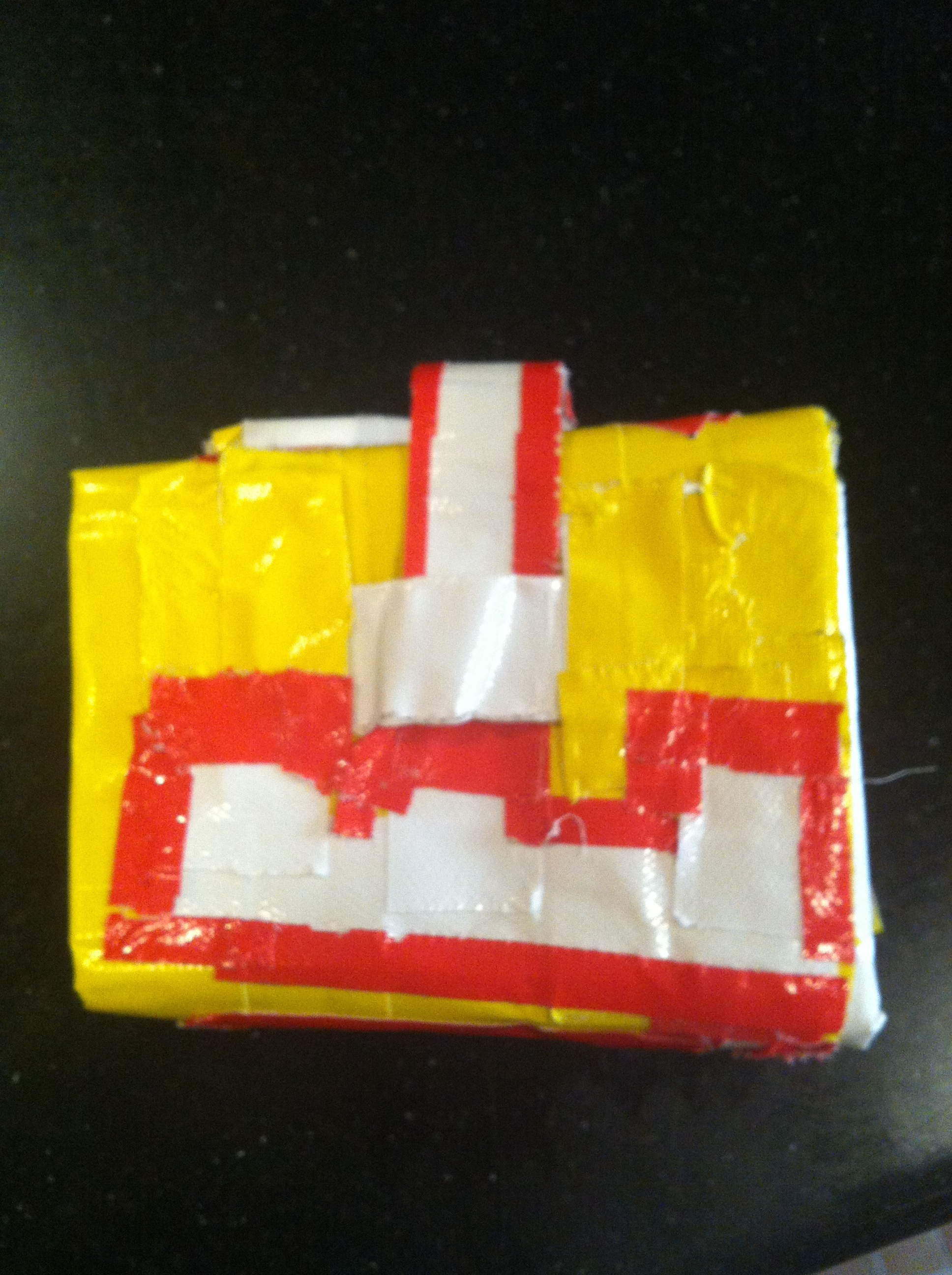 A duct tape wallet gifted to Kiddo from a little girl at summer camp. This is serious craftsmanship by a 10-year-old (it even has slots inside for pictures and credit cards, and has Kiddo's name etched out in red and white tape). I have a feeling someone is spending a lot of quality time with a Doha stay-at-home dad living out every man's duct tape crafting fantasy.