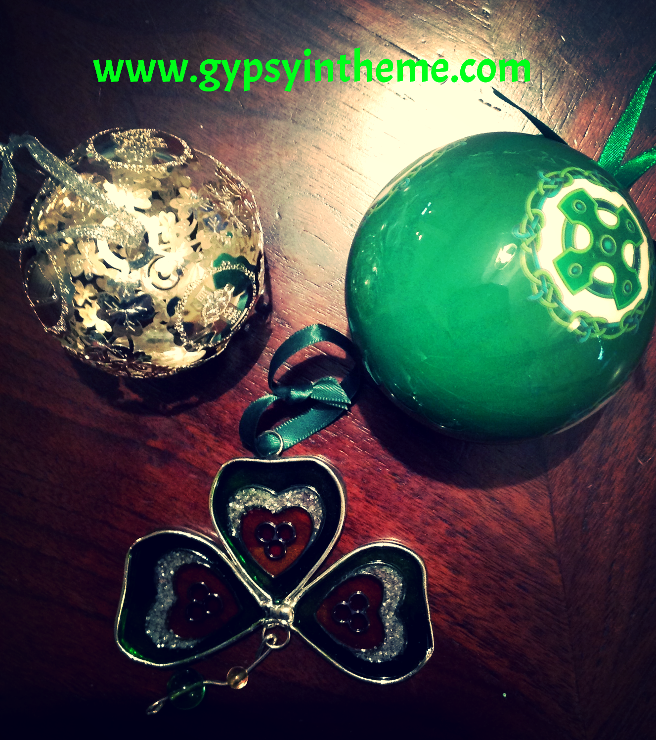 The silver hand-crafted ornament on the top left was a gift from Smilin' Vic on a trip to Ireland in 2009.  It kick-started the trend of buying a Christmas memento in every port.  The other two were bought when we toured South-Western Ireland last summer.