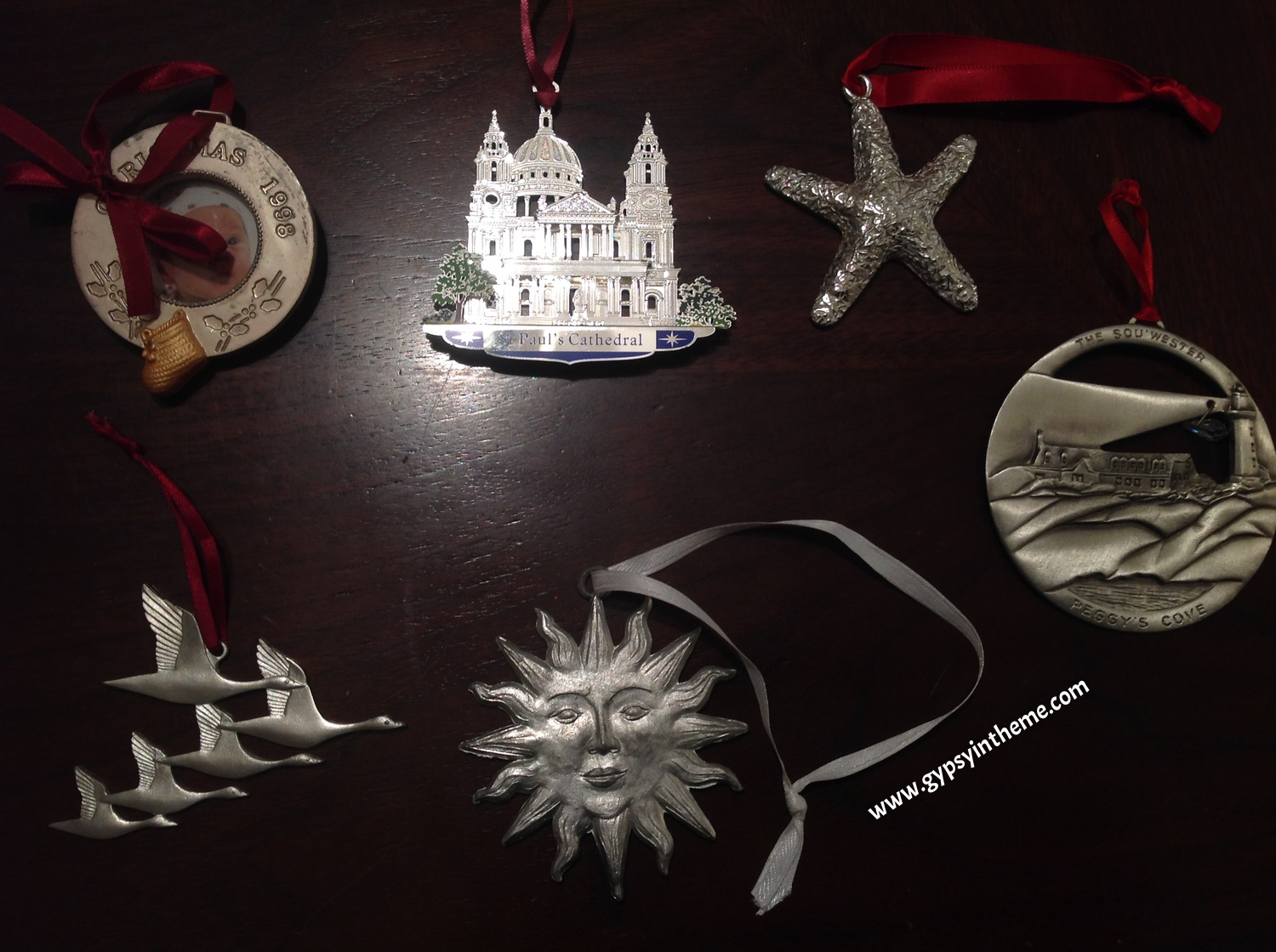 A collection of pewter ornaments from over the years ... from top left, clockwise:  (1) a picture of my godson from New Brunswick, and souvenirs from trips to (2) London, (3) PEI, (4) Halifax, (5) Zurich, and (6) the Cabot Trail.