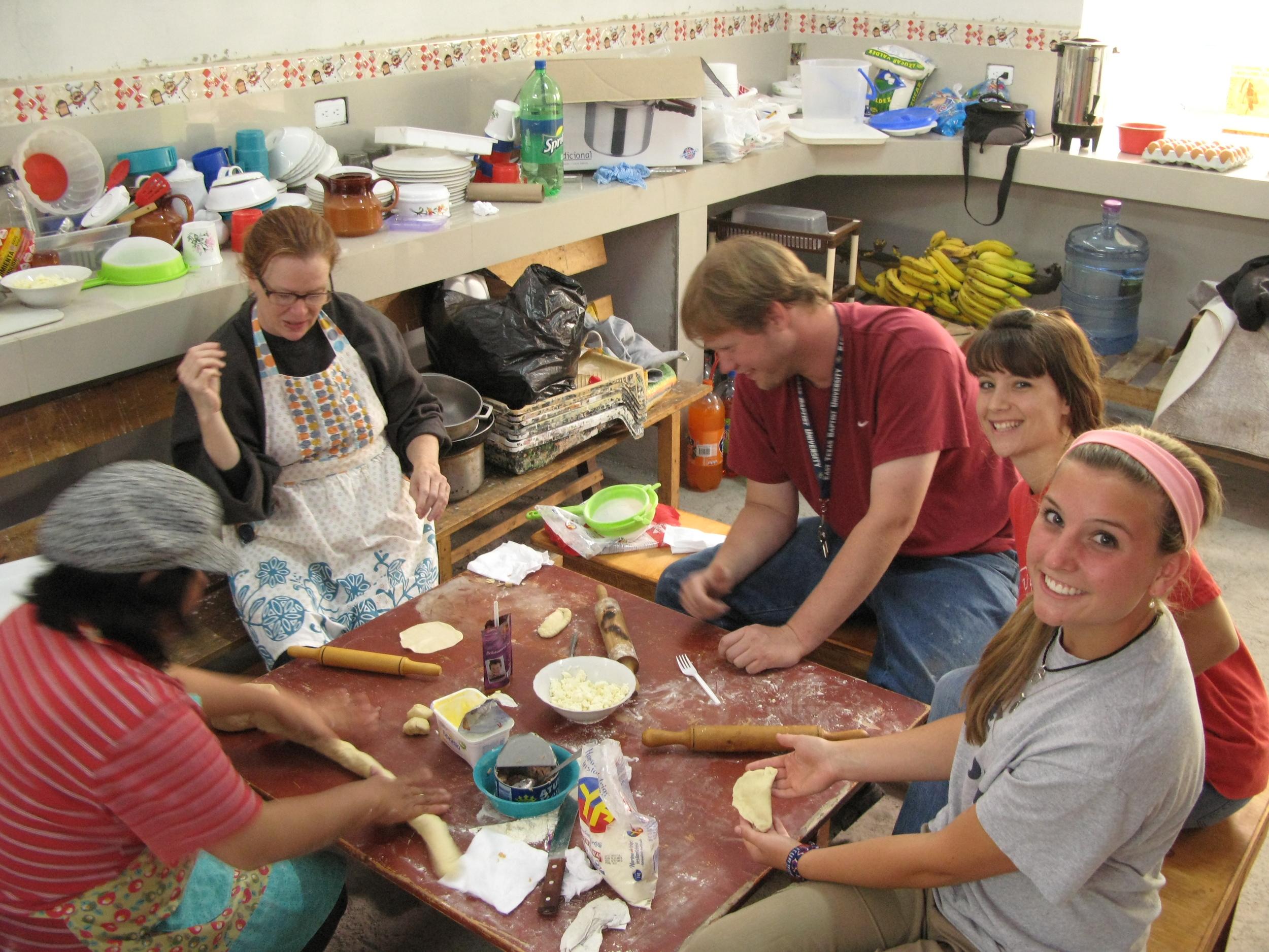 Jenny, pastor Hernan's wife, teaching North Americans how to make empanadas