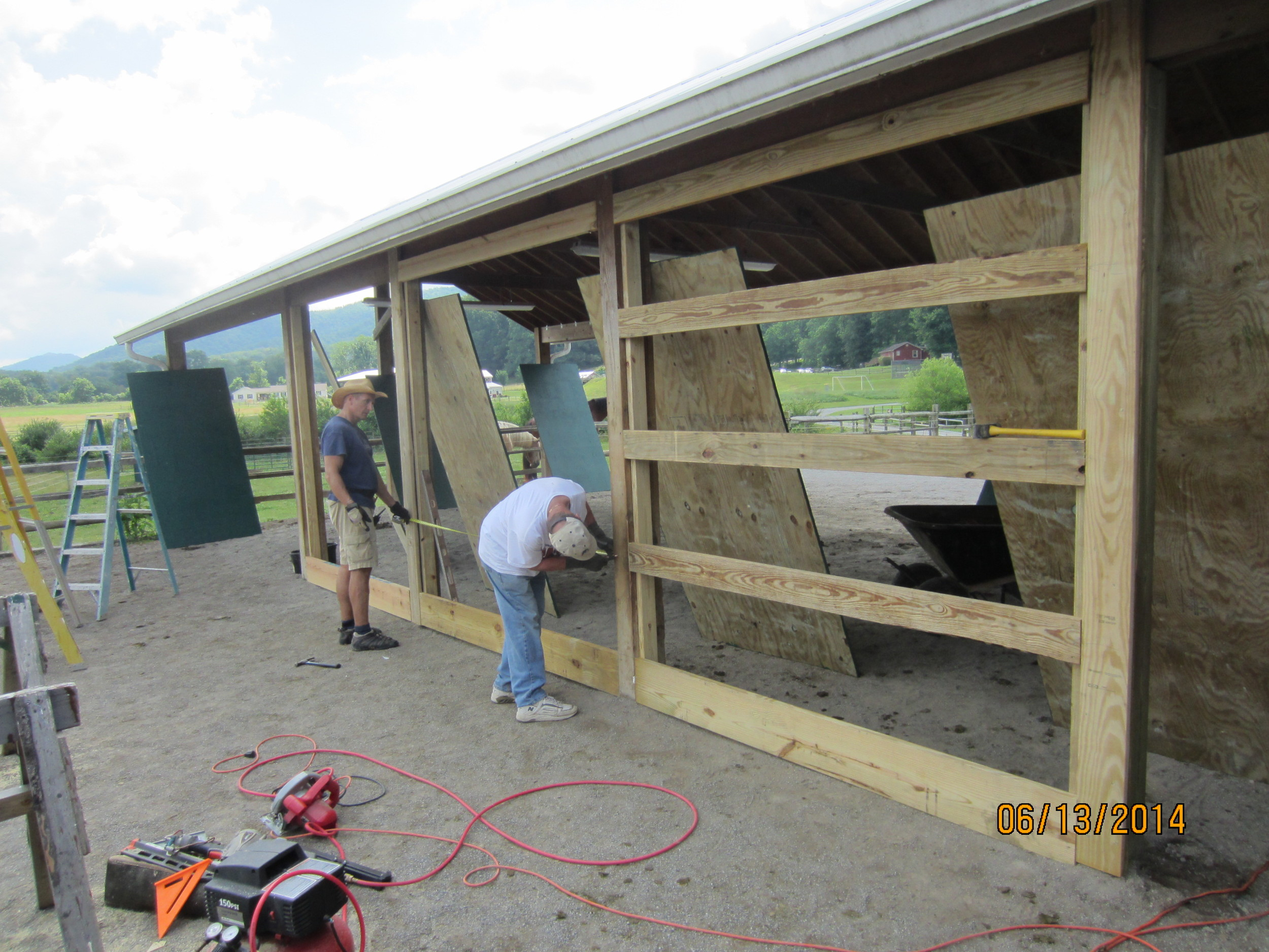 Building a curtain wall at the stables.