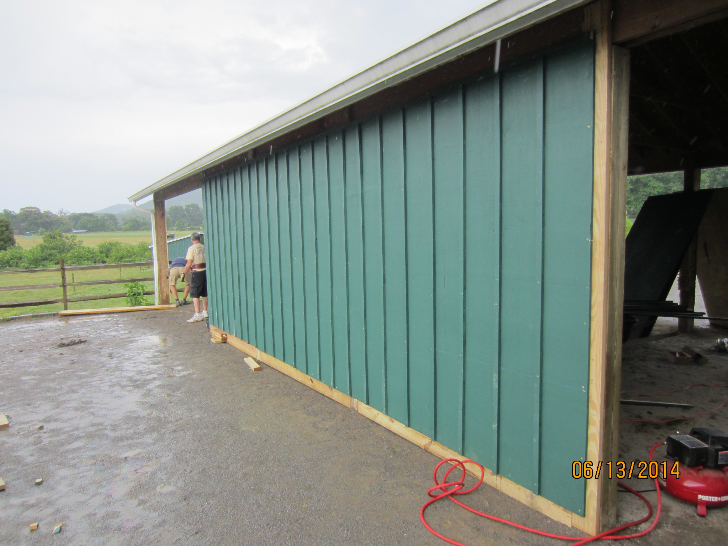 The Stables curtain wall is complete on one side. Kerry Higgins is in the background.