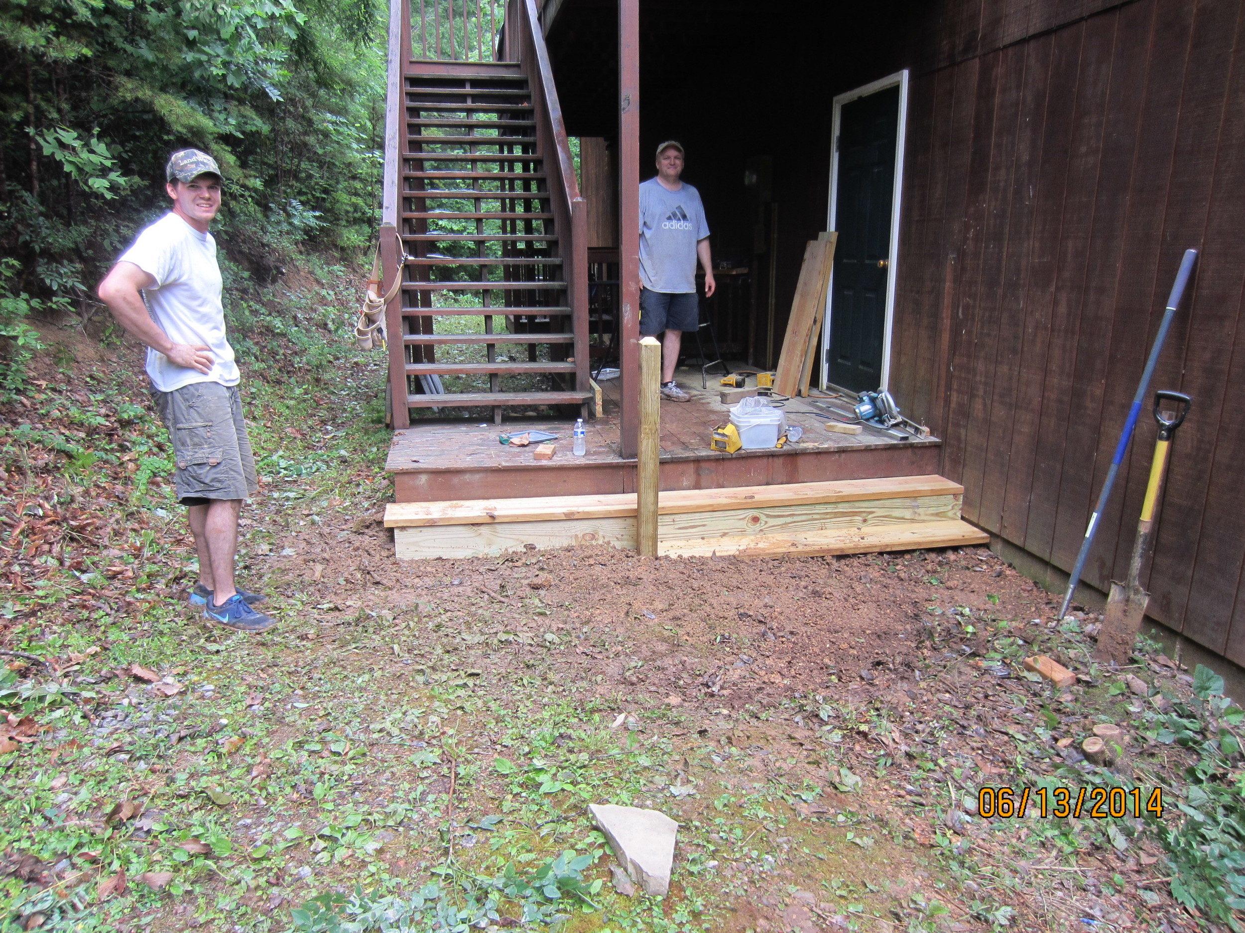 Philip and Evan Stout finishing up the new steps for the back of the Dormitory building.