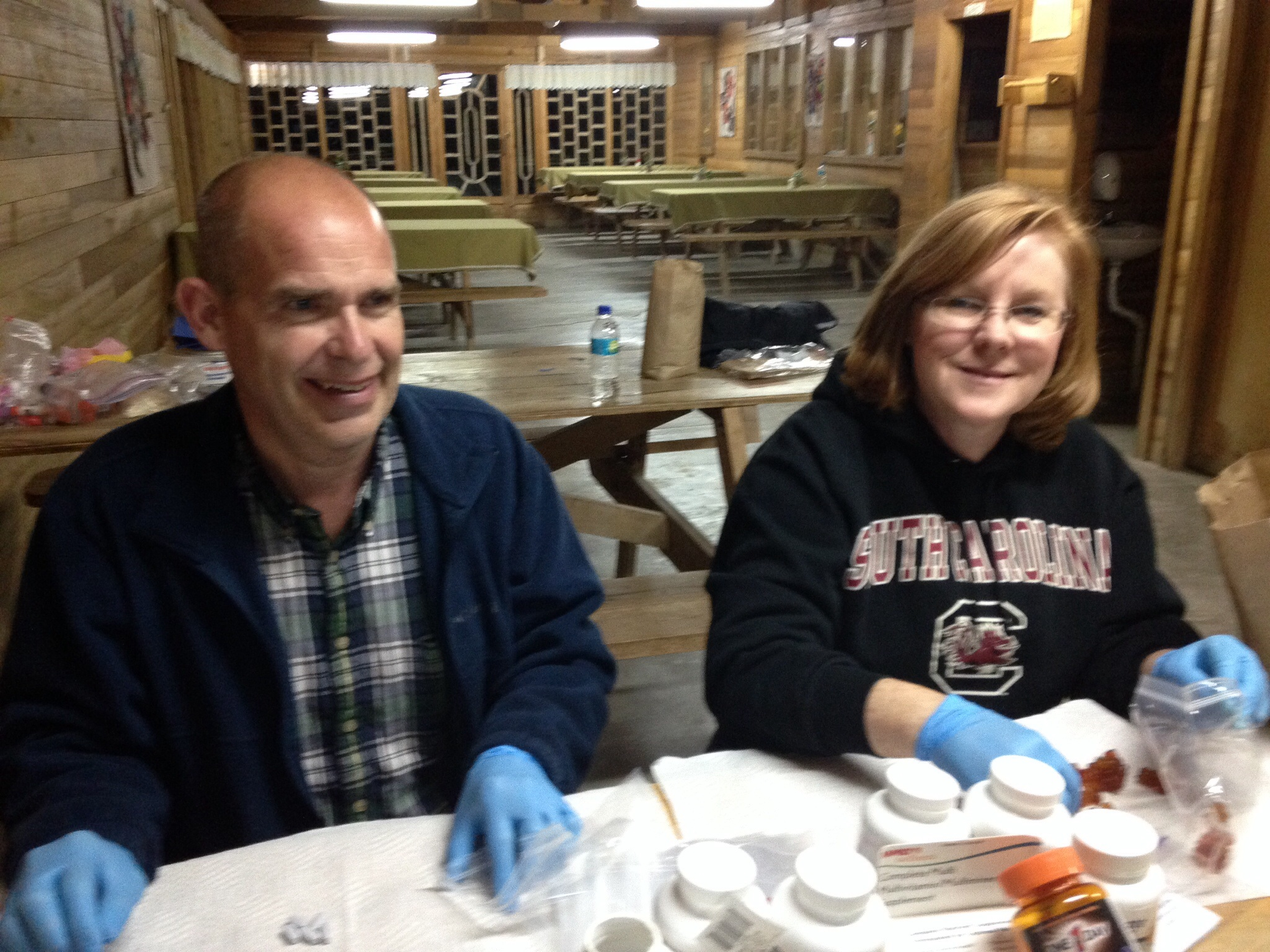 Dr. Gina and Roy prepare medications for the clinics