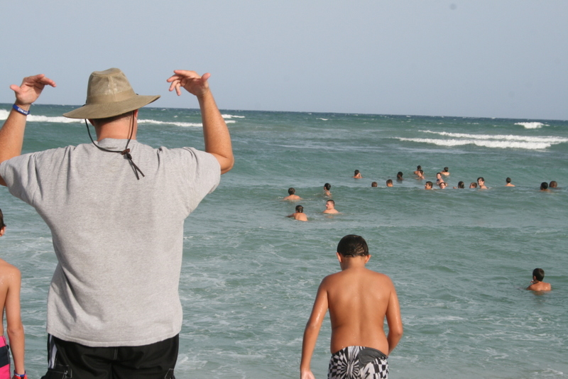 Brad calling the boys in from the ocean... they eventually came.