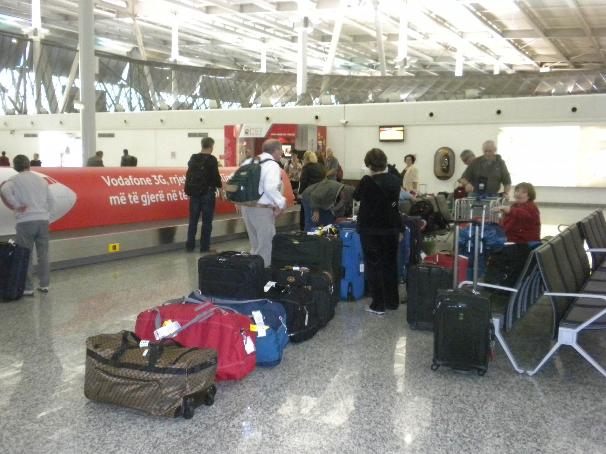Gathering all of our luggage at the airport in Tirana...we were thrilled when all 14 pieces of luggage showed up!