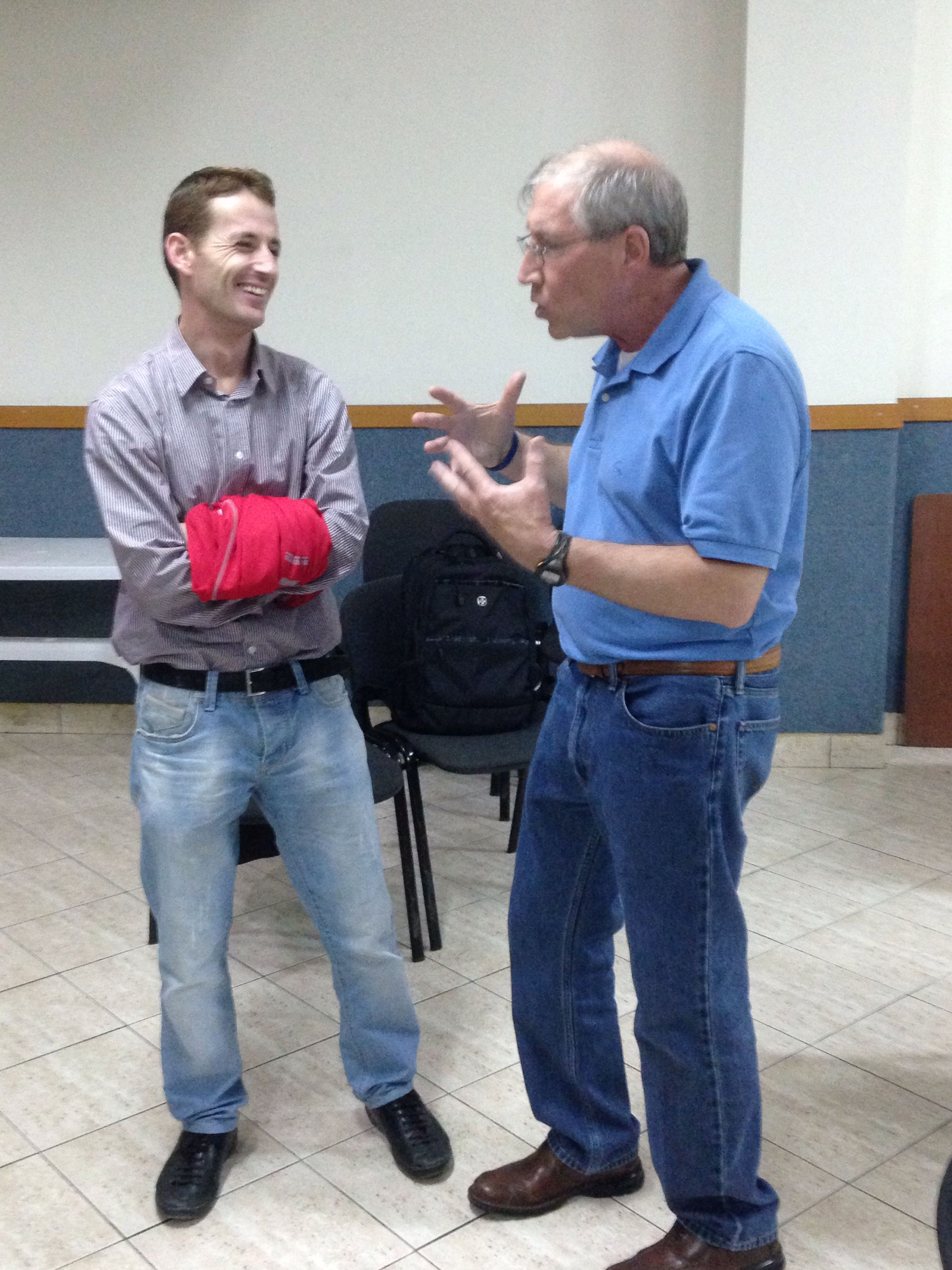 Gusti, the leader of Jete Studentore Tirana, talking to Jim