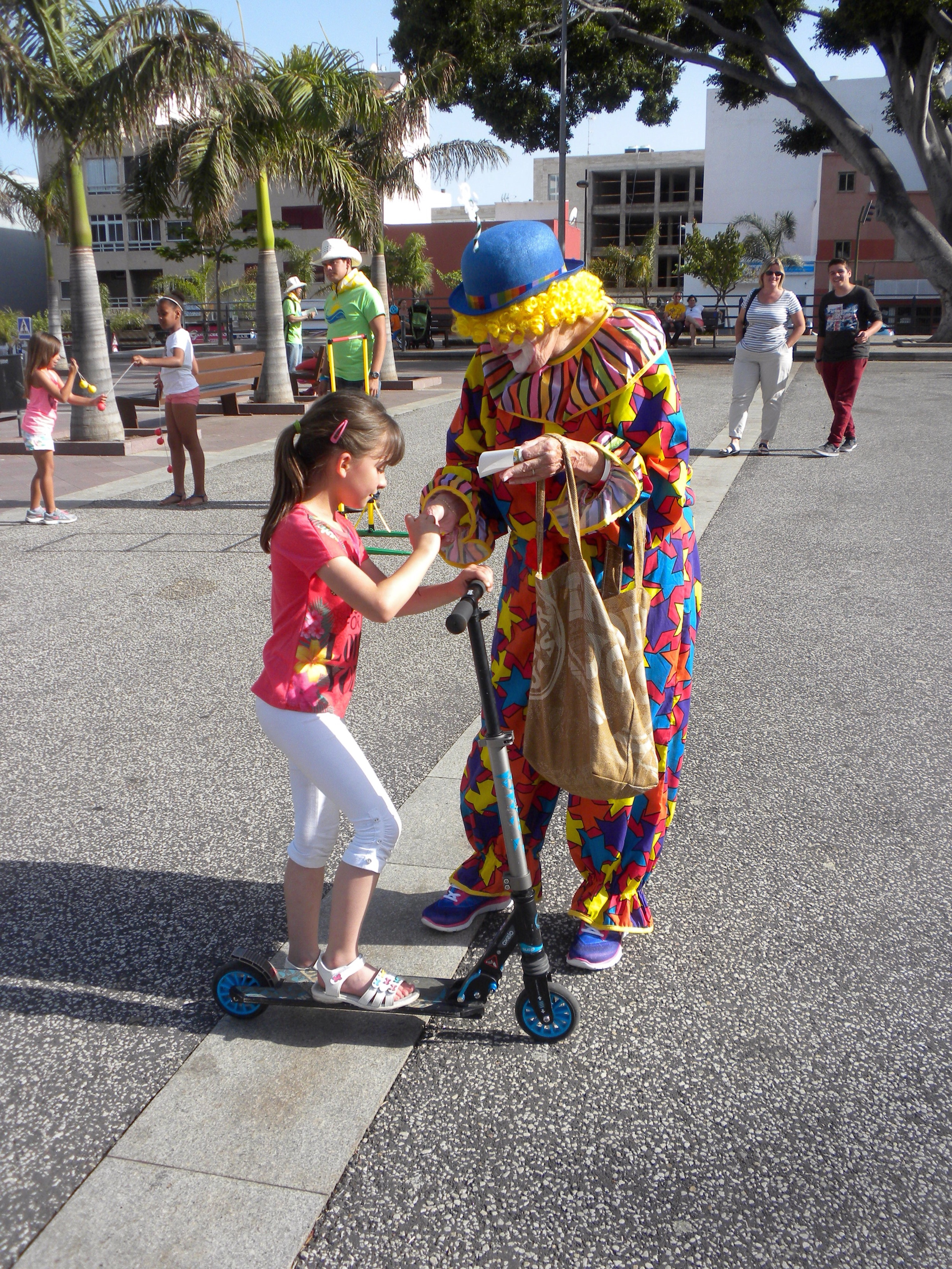 Our clown gave candy to the children.