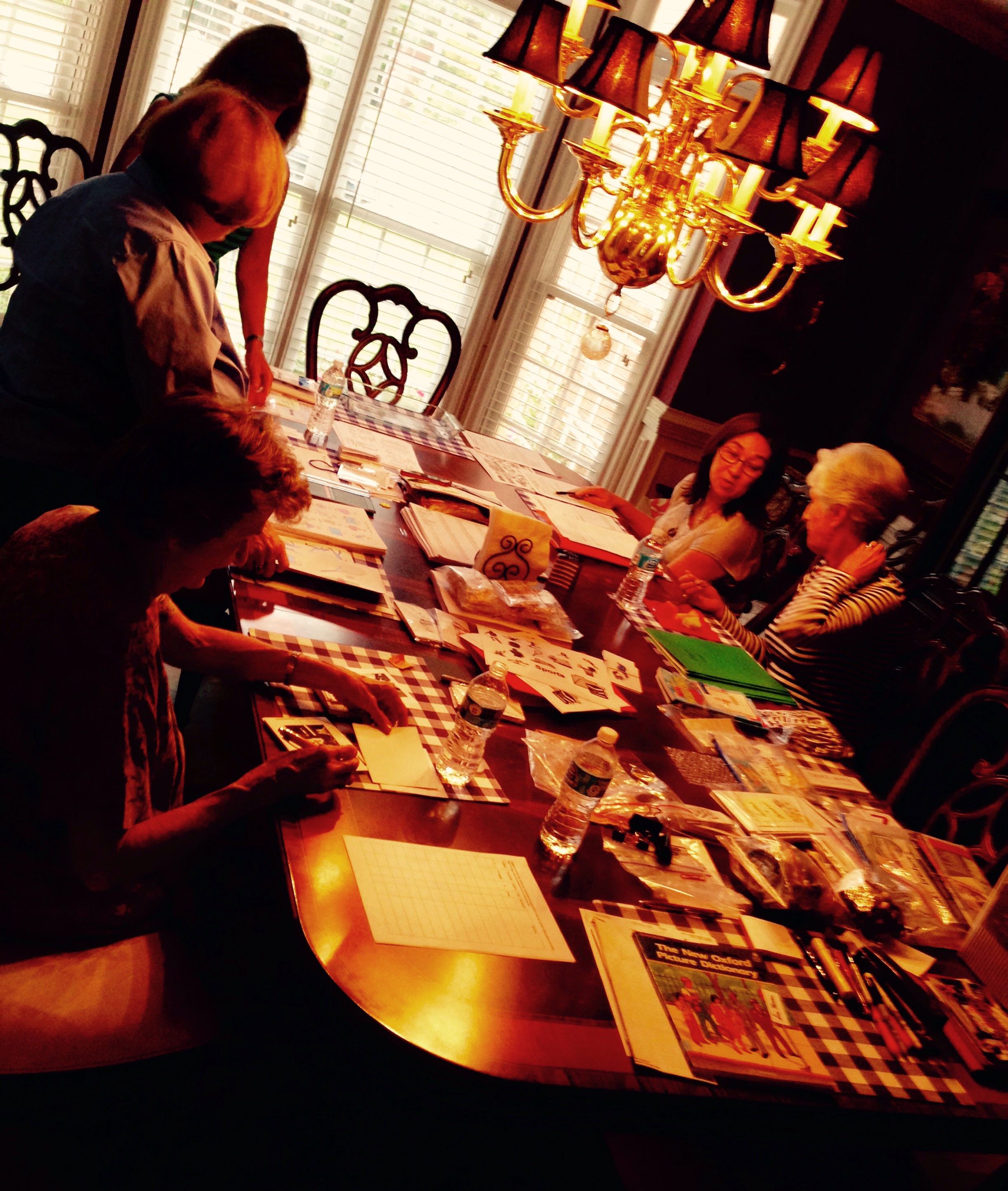 The women were putting image flash cards together for the classes.