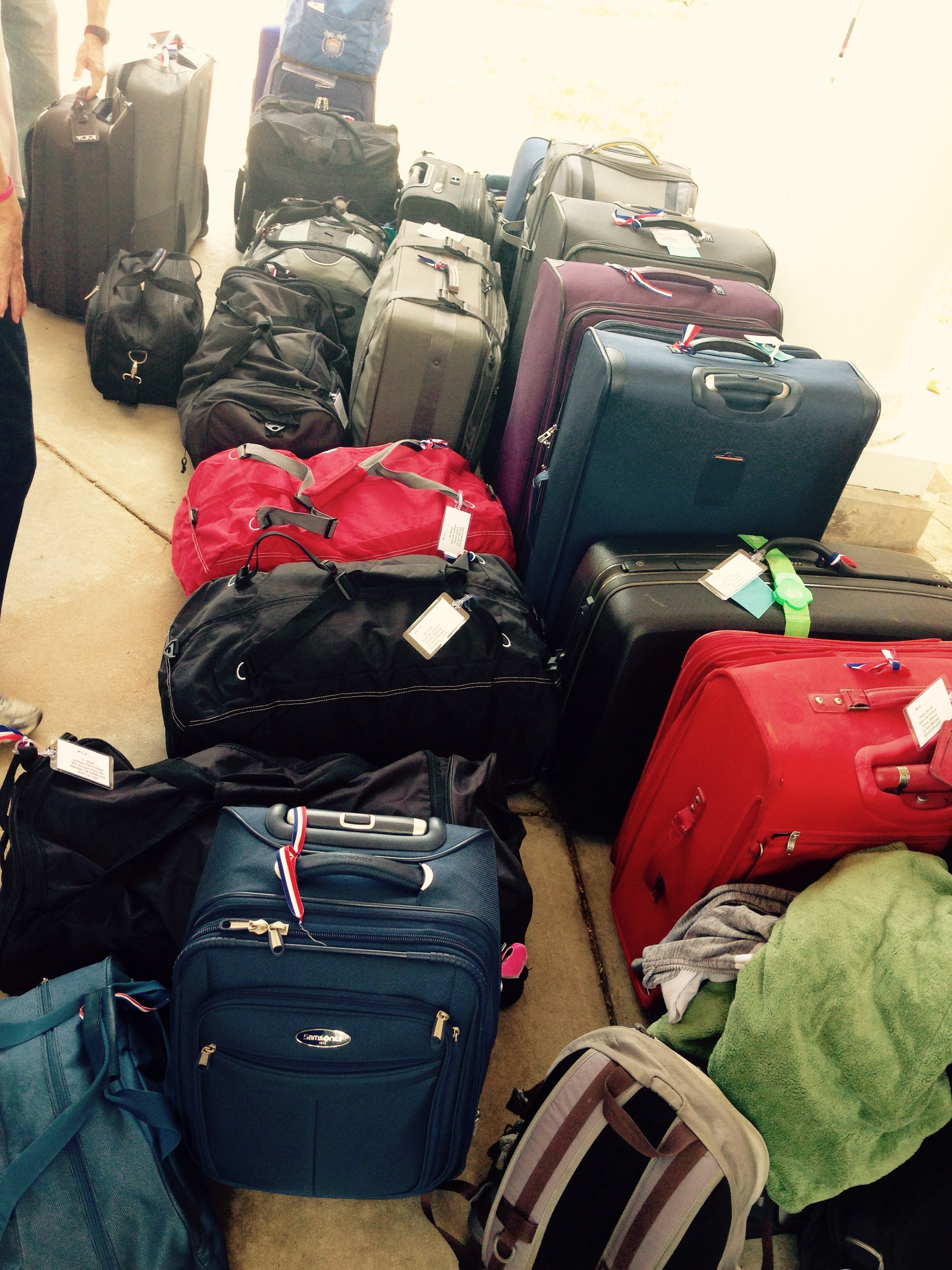 21 checked bags, 12 personal carry-ons, and at least 5 regular carry-ons