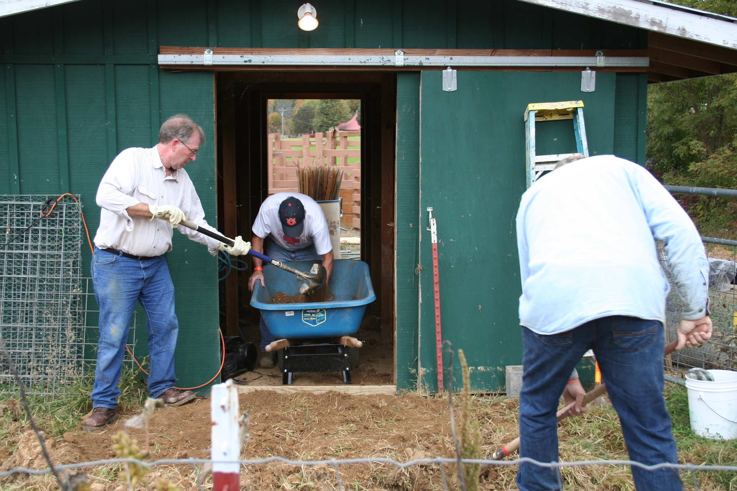 Here they are sifting the dirt for the floor of the lamb barn.