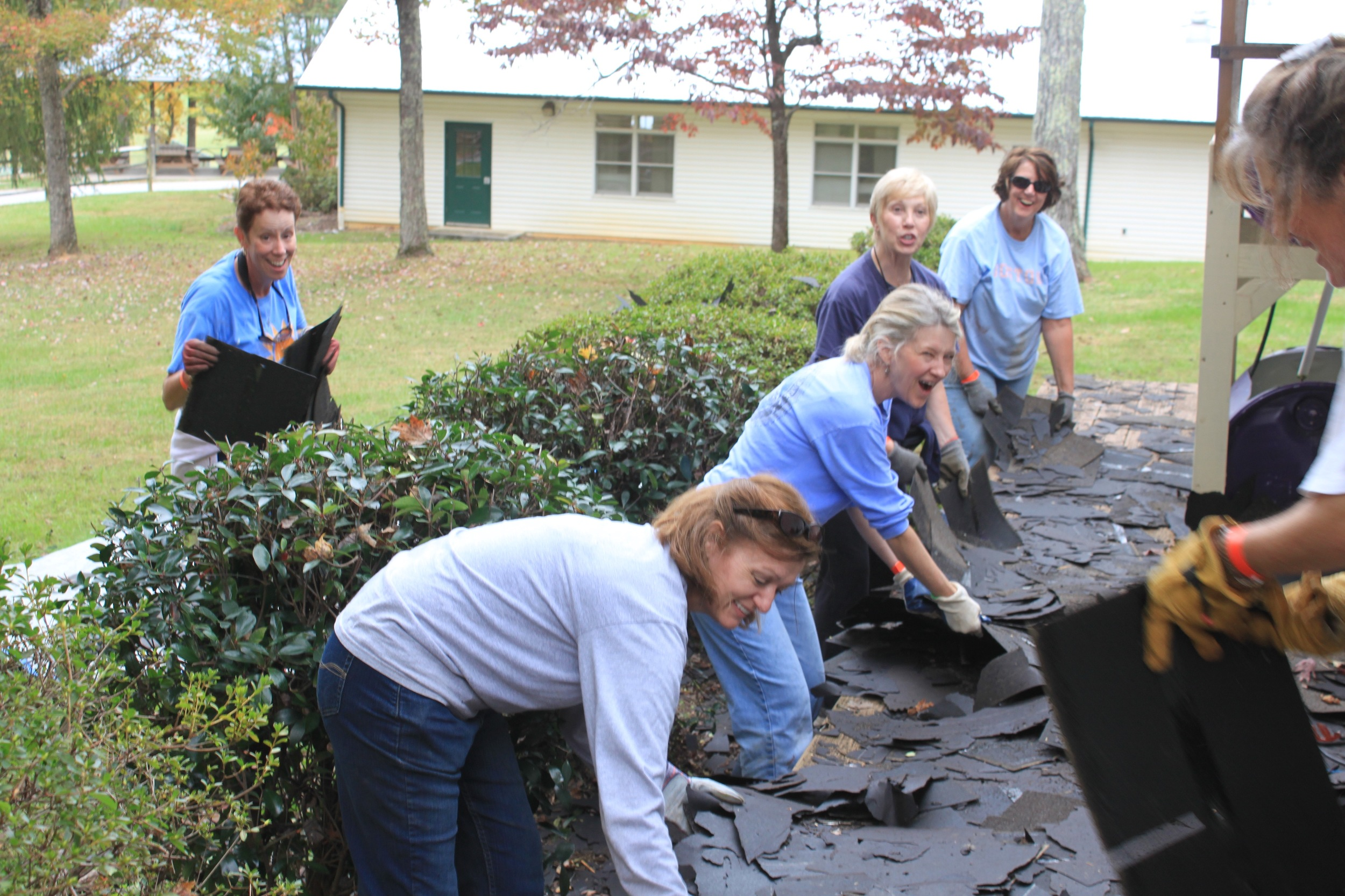 The flexible staining team took on the challenge to transport all of these shingles to the dumpster.