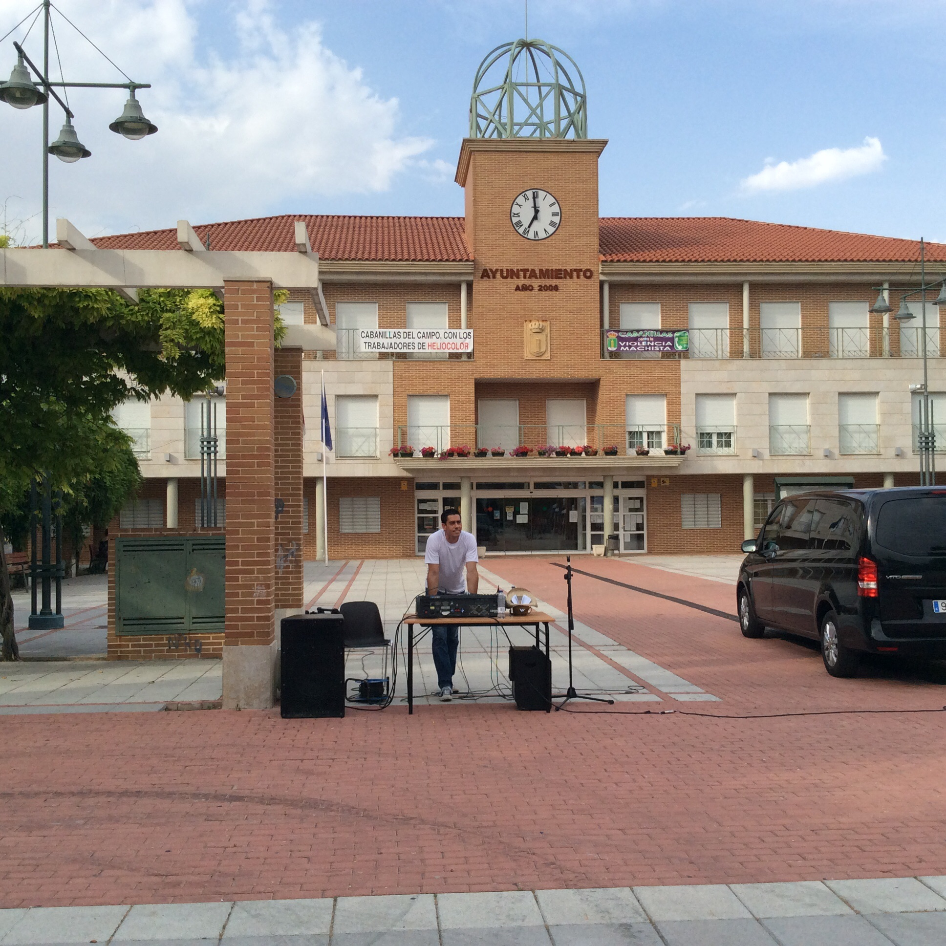 DJ Manny spinning country tunes in front of city hall.