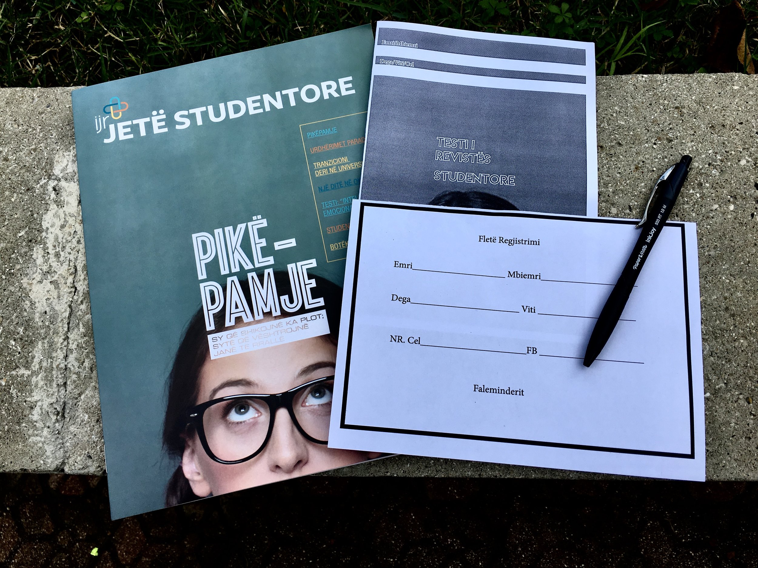 The student magazine, the test they can take to possibly win an iPad mini, and the sheet each student would complete with their contact information