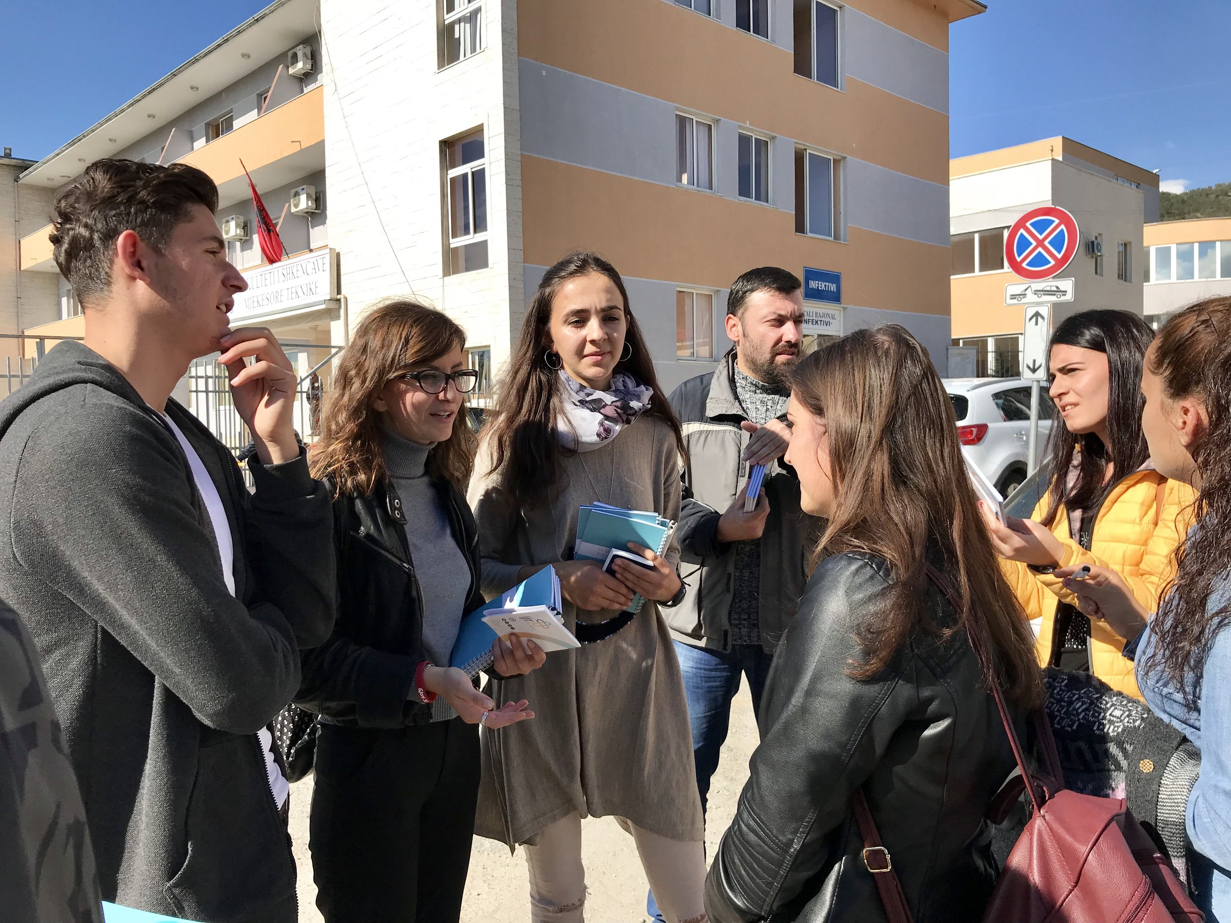 Talking with students outside the university entrance