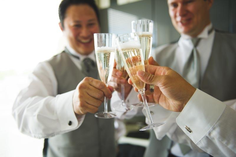 Grooms Champagne Cheers.jpg