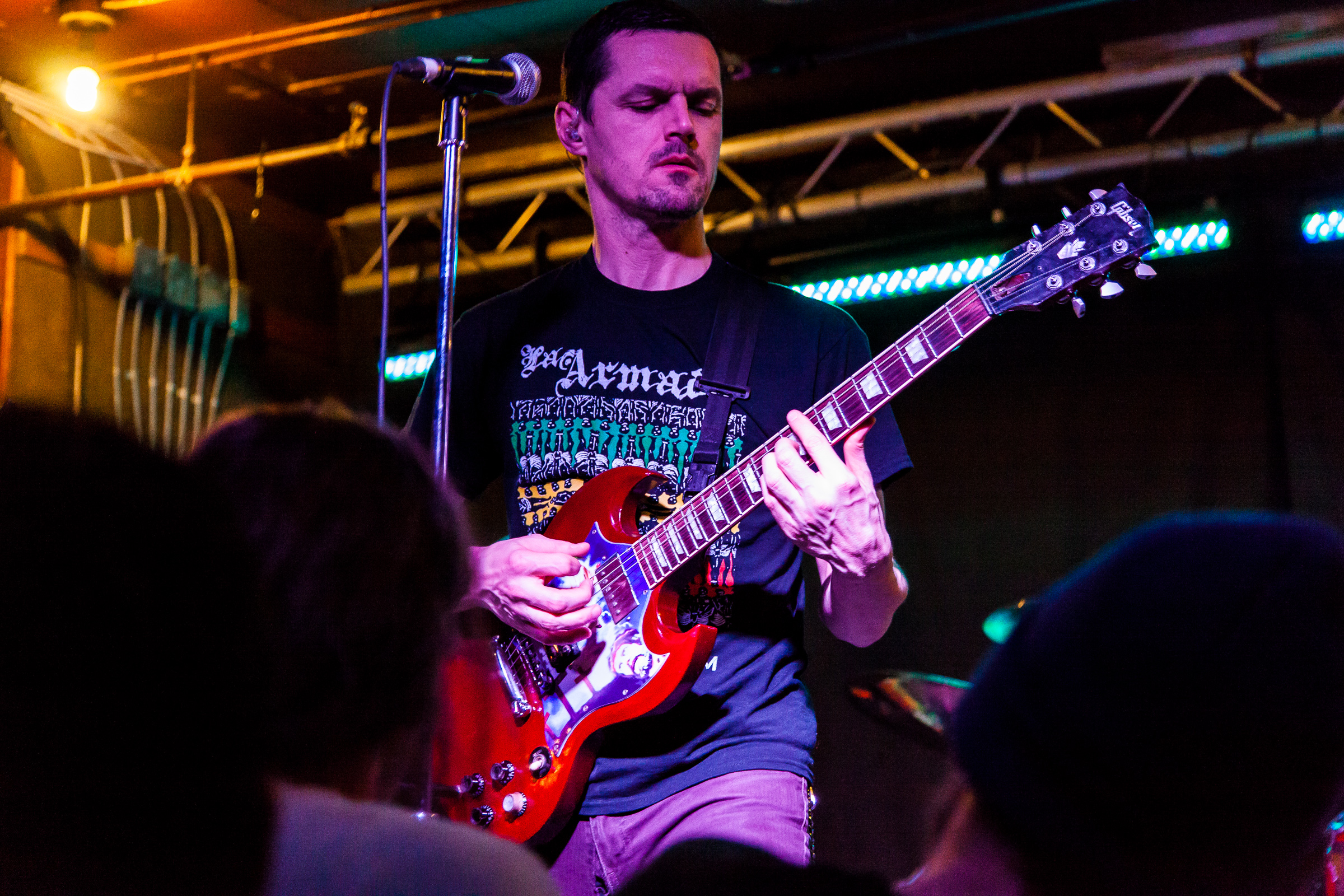 Though it was New Years Eve 2013 Propagandhi didn't grace the stage at the Windsor until just minutes after Midnight. This was one of the best evenings ever. Propagandhi, though Winnipeg locals, only ever play in their hometown once every couple years, usually in much larger venues to bigger always sold out crowds. The New Years Eve show was announced with practically no notice and tickets sold out within minutes. I stood in line on a cold December morning in the Exchange waiting for Into the Music to open their doors and pick up the hottest ticket in town. But like many others I was left in the cold, ticketless and irritable. But thanks to the kindness of friends Melissa and I, along with many of those faces behind me in line, got to ring in the New Year with some of the raddest dudes around.