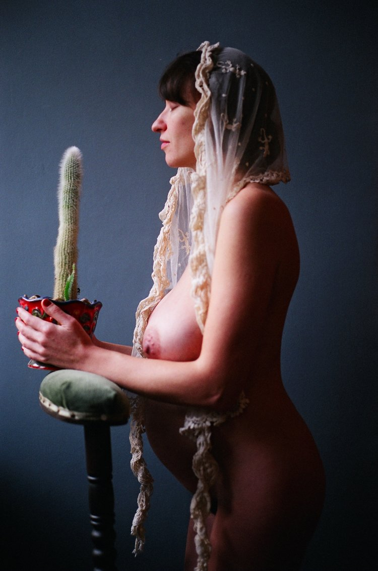Woman Praying With Cactus, Cologne, 2011