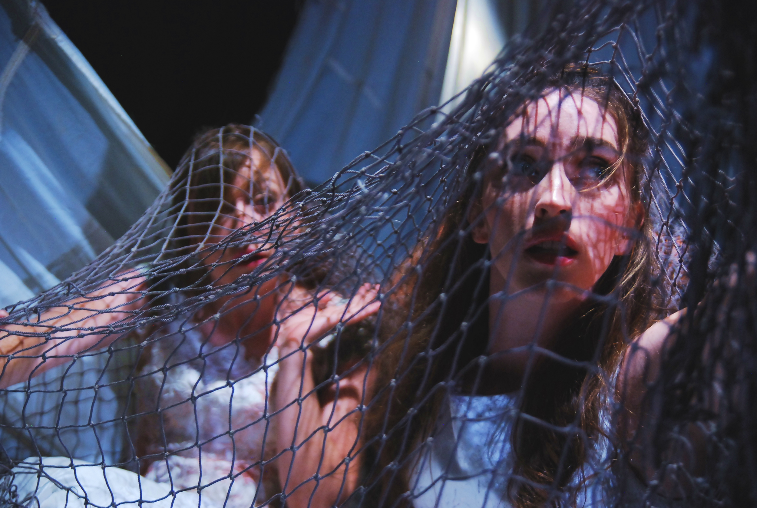Jennice Butler (left)as Leta and Mercedes Manning (right) as Philomena in The Pliant Girls , Fugitive Kind's Ovation Award-winning production loosely based on Aeschylus's The Suppliants .  Photo courtesy of Amanda McRaven   Download print quality(300 dpi)