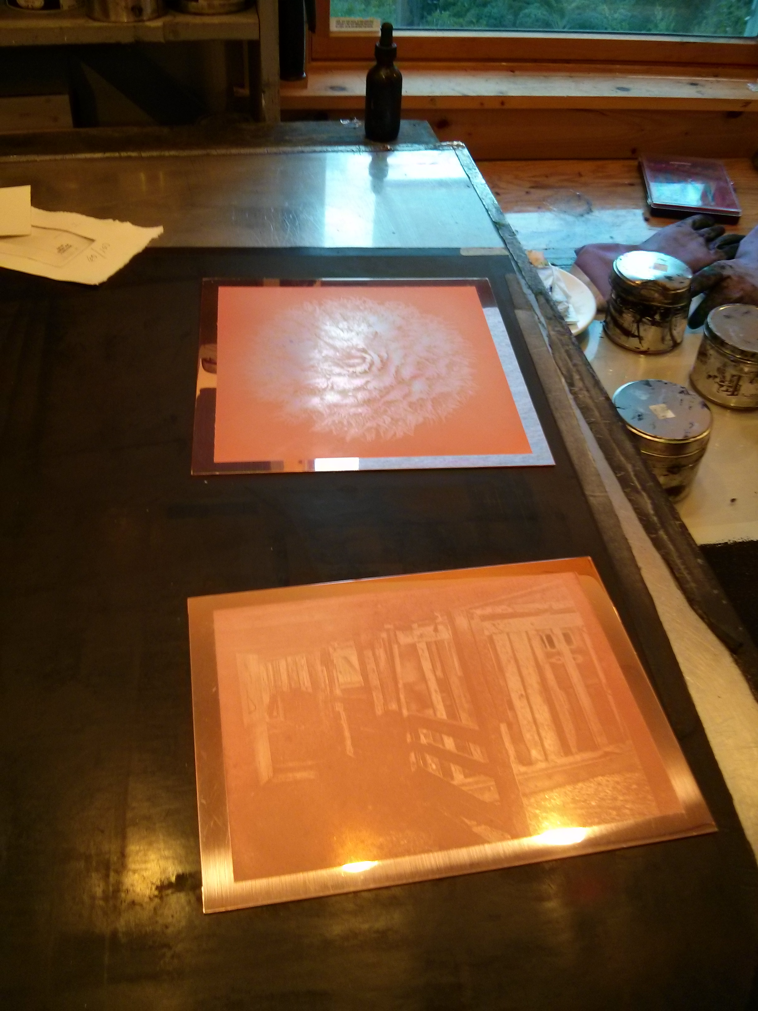 Two copper gravures ready to be inked.