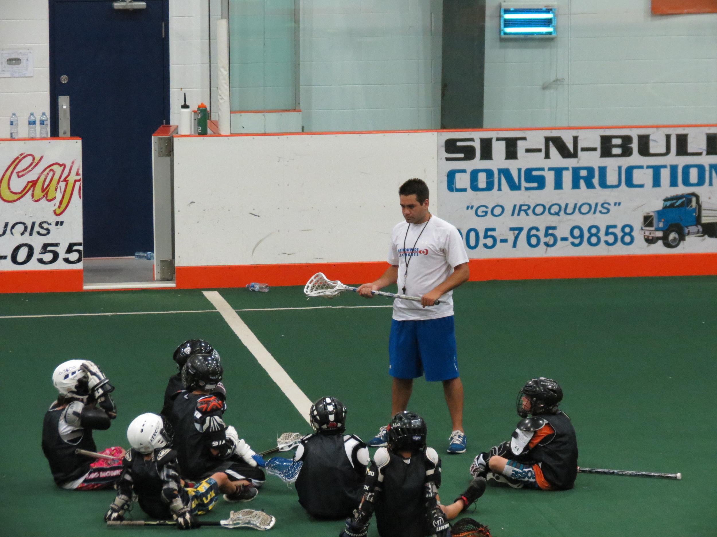 Shawn Evans instructing kids
