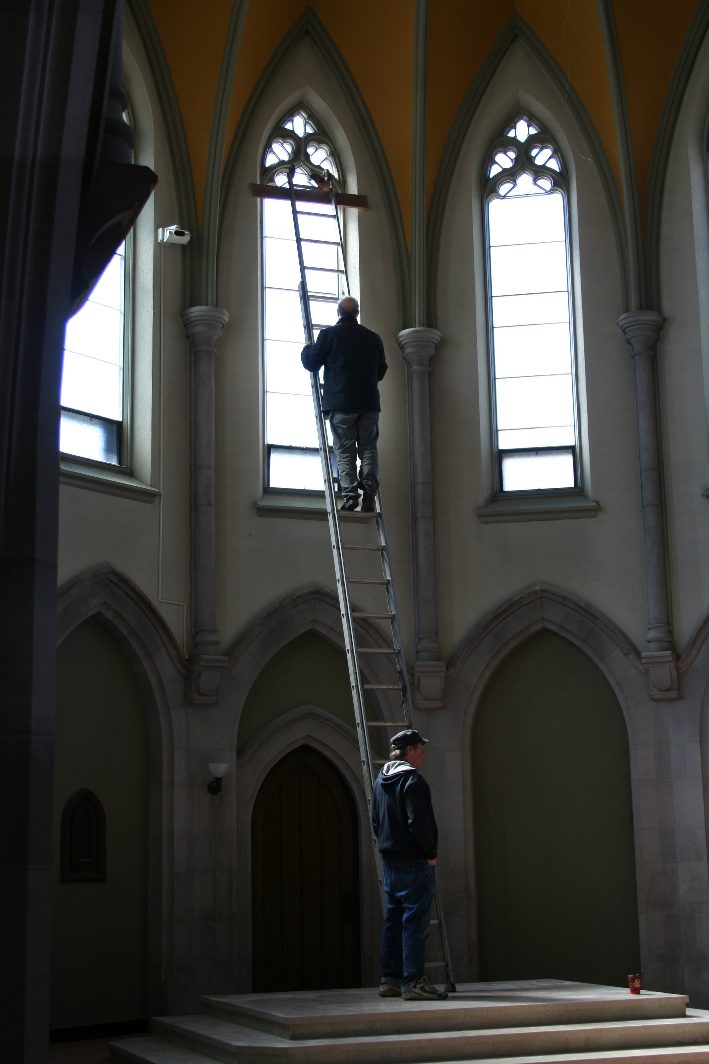 Public Energy Artistic Producer Bill Kimball helping Artist Robert Edmonson install his kinetic sculpture in the Chapel. Photo: Paul Oldham