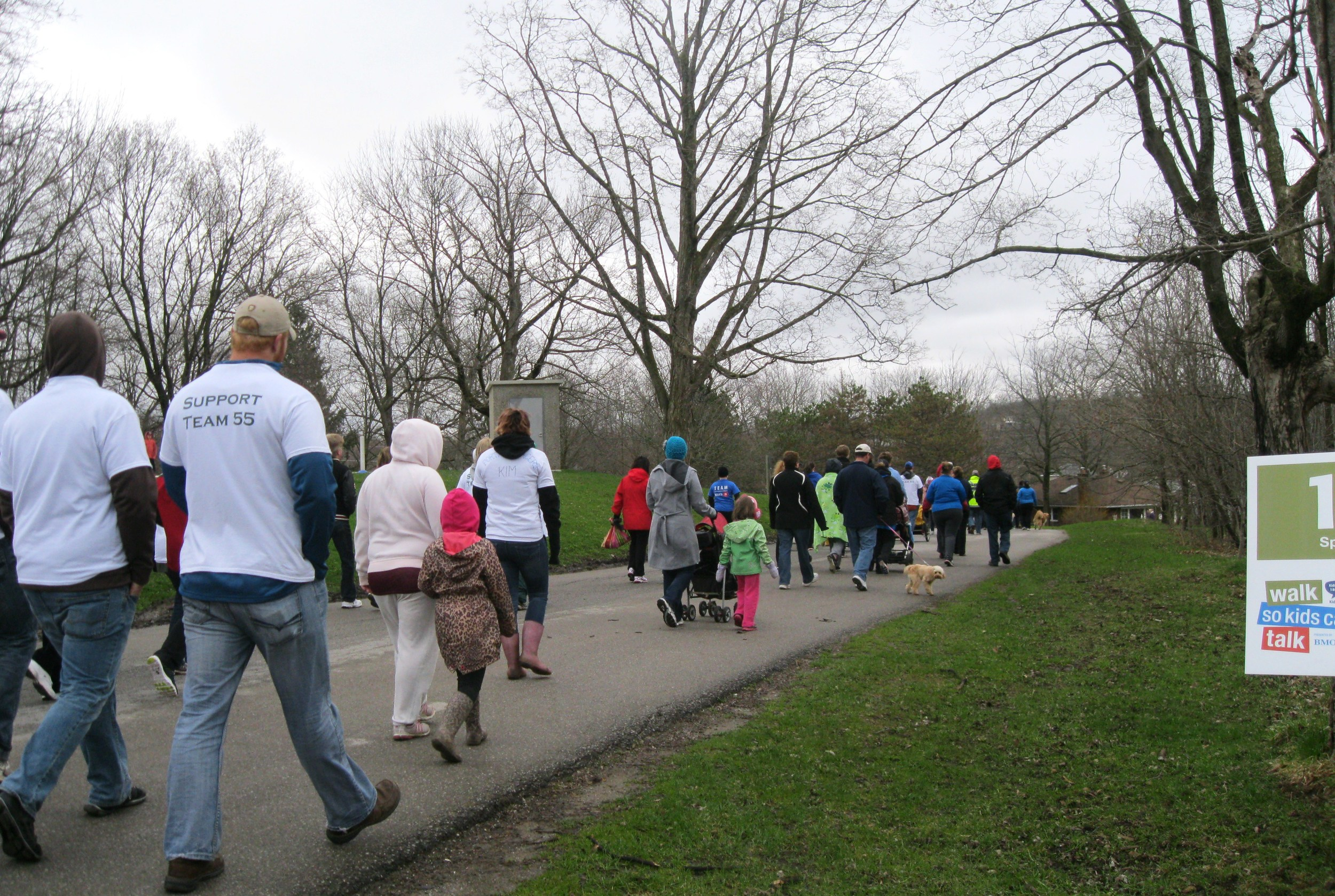 Adults, kids and pets alike take off for their first kilometer of the walk