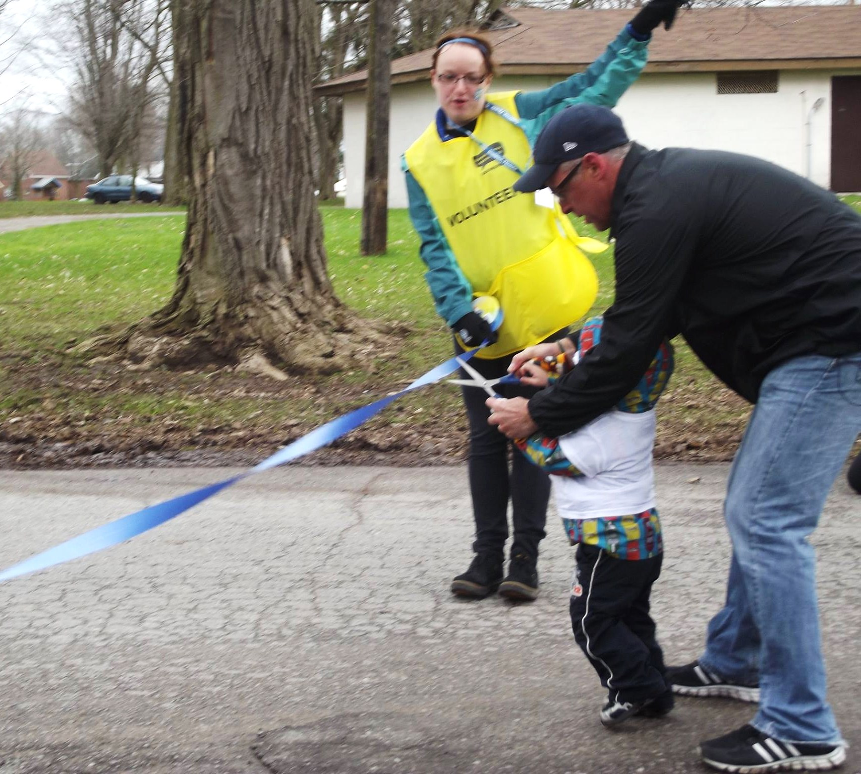 David Pogue of Team 55 and his grandson cut the blue ribbon to mark the official start of the walk and honour his son Mitchell