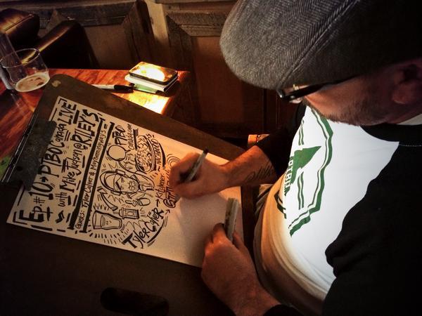 Artist Jason Wilkins  illustrating podcast  (photo Maryam Monsef)
