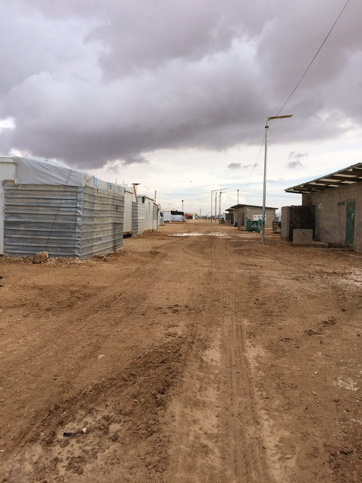 Above left: Some of the caravans within which people live at the refugee camp. Above right: communal bathrooms