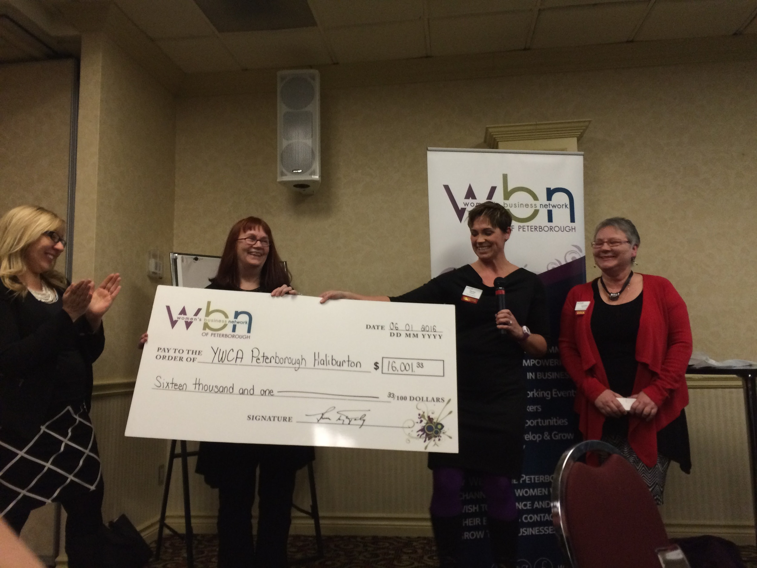 YWCA Executive Director Lynn Zimmer accepts cheque