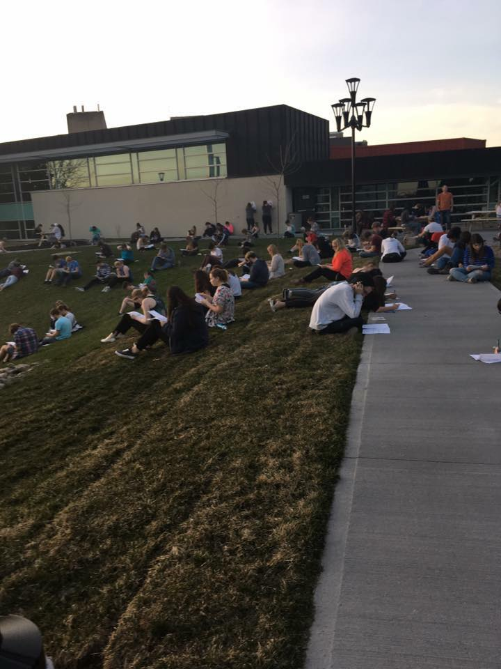 Trent Forensic Class writes exam outside (photo via  Trent University Forensic Class Facebook page )