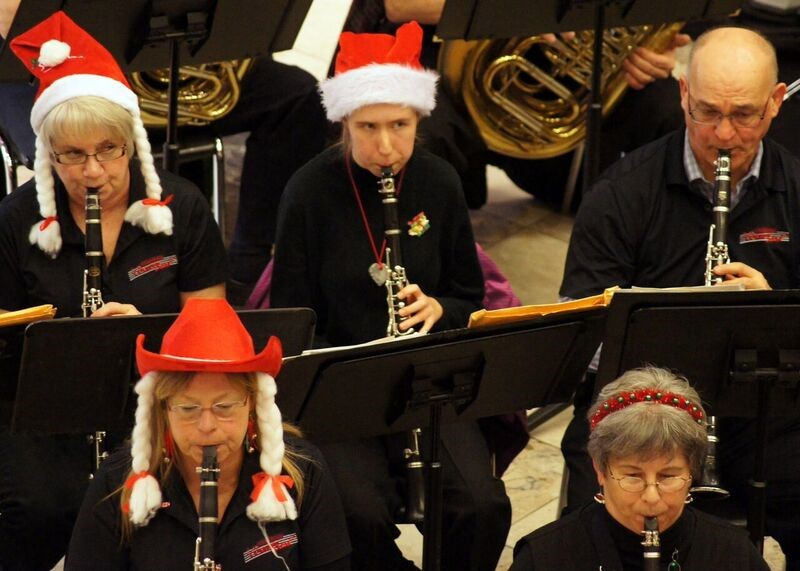 Members of the band get into the holiday spirit at a free concert at Peterborough Square before the Santa Claus Parade