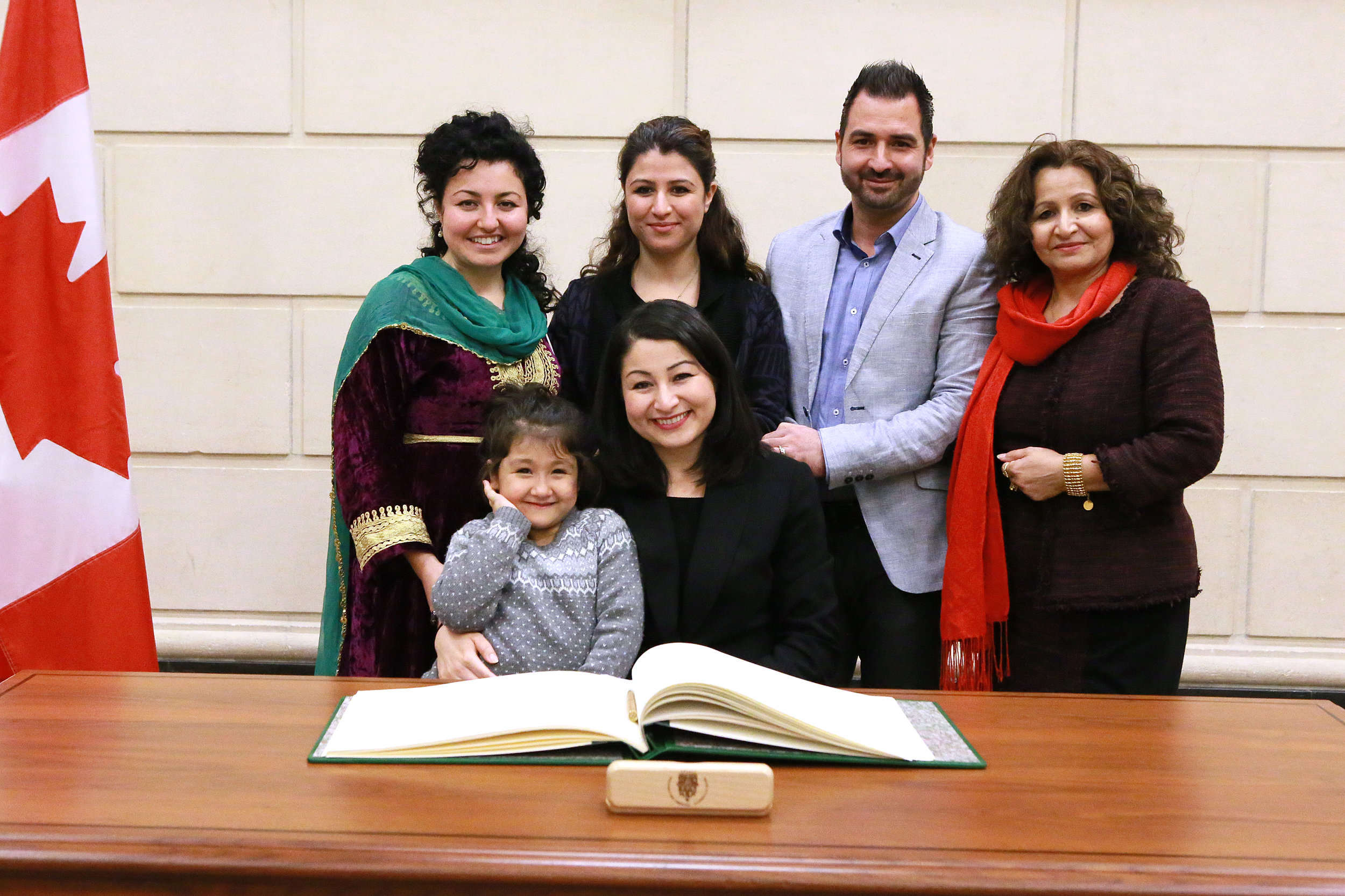Photograph of Maryam with her family. The photograph was taken at her swearing-in ceremony as the Member of Parliament for Peterborough-Kawartha, which occurred at the House of Commons on November 24, 2016.  Clockwise starting on the left:  the family are Mehrangiz Monsef, Mina Monsef, Mehdi Taheri (Mina's husband), Soriya Basir-Monsef, Maryam Monsef, Leila Taheri (Mina & Mehdi's daughter).