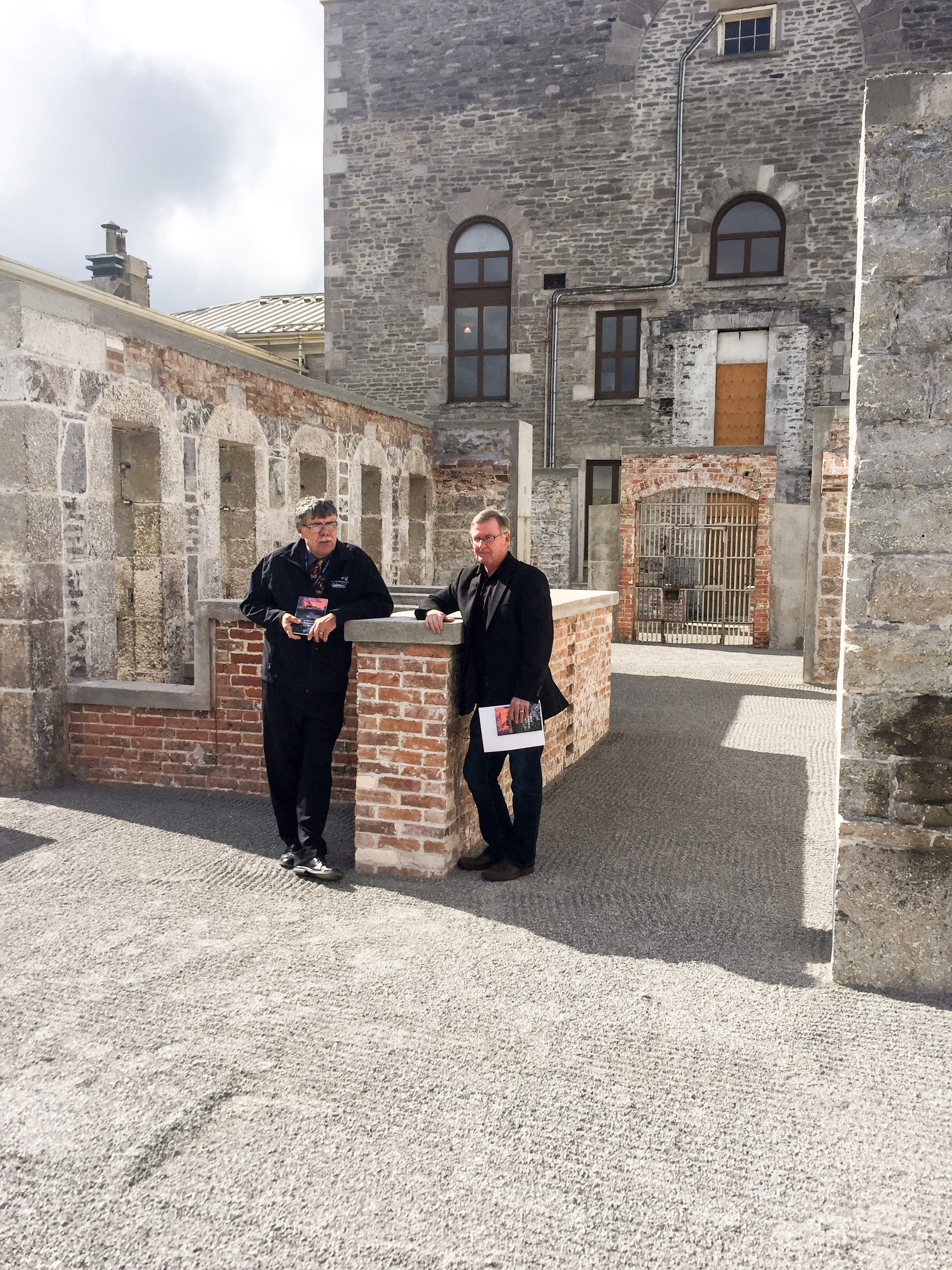 Warden J. Murray Jones (at left) with Ed Arnold at the old County Jail site (photo by Scott Arnold)