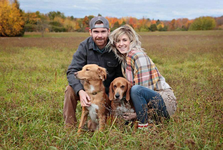 Engagement photo of Jesse and Niki with their rescue dogs taken by Kathy Jones Traynor