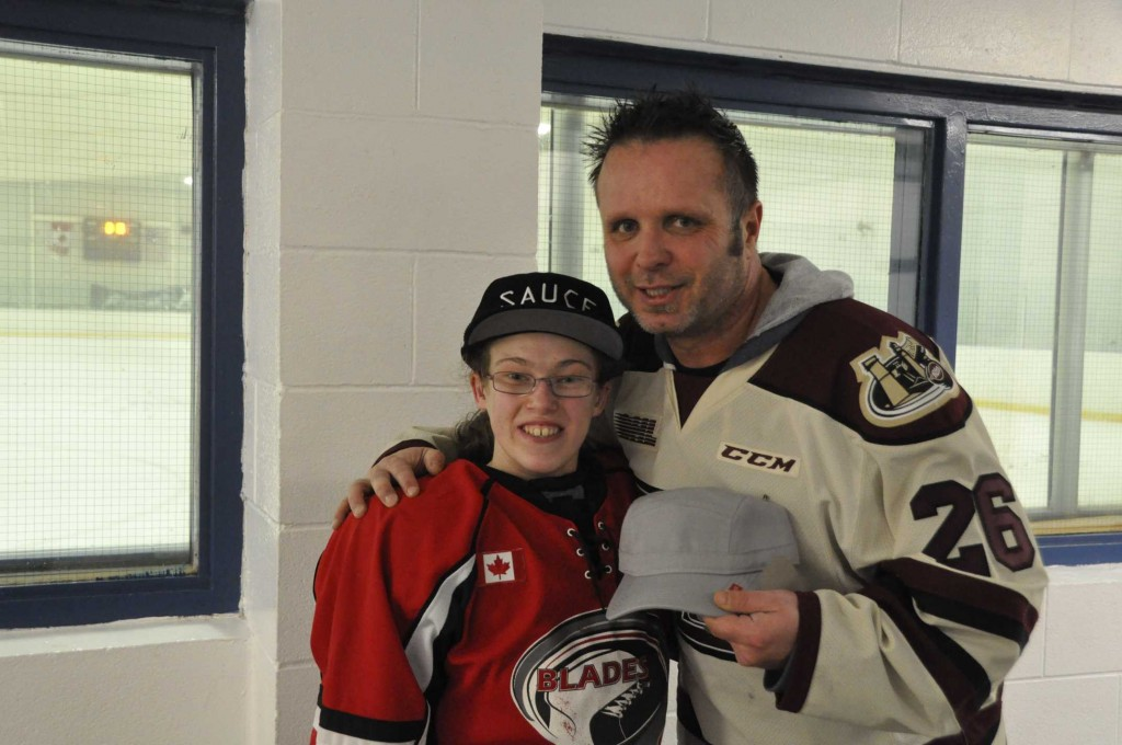 Peterborough Huskies coach Chris J-Boy Williams with one of players