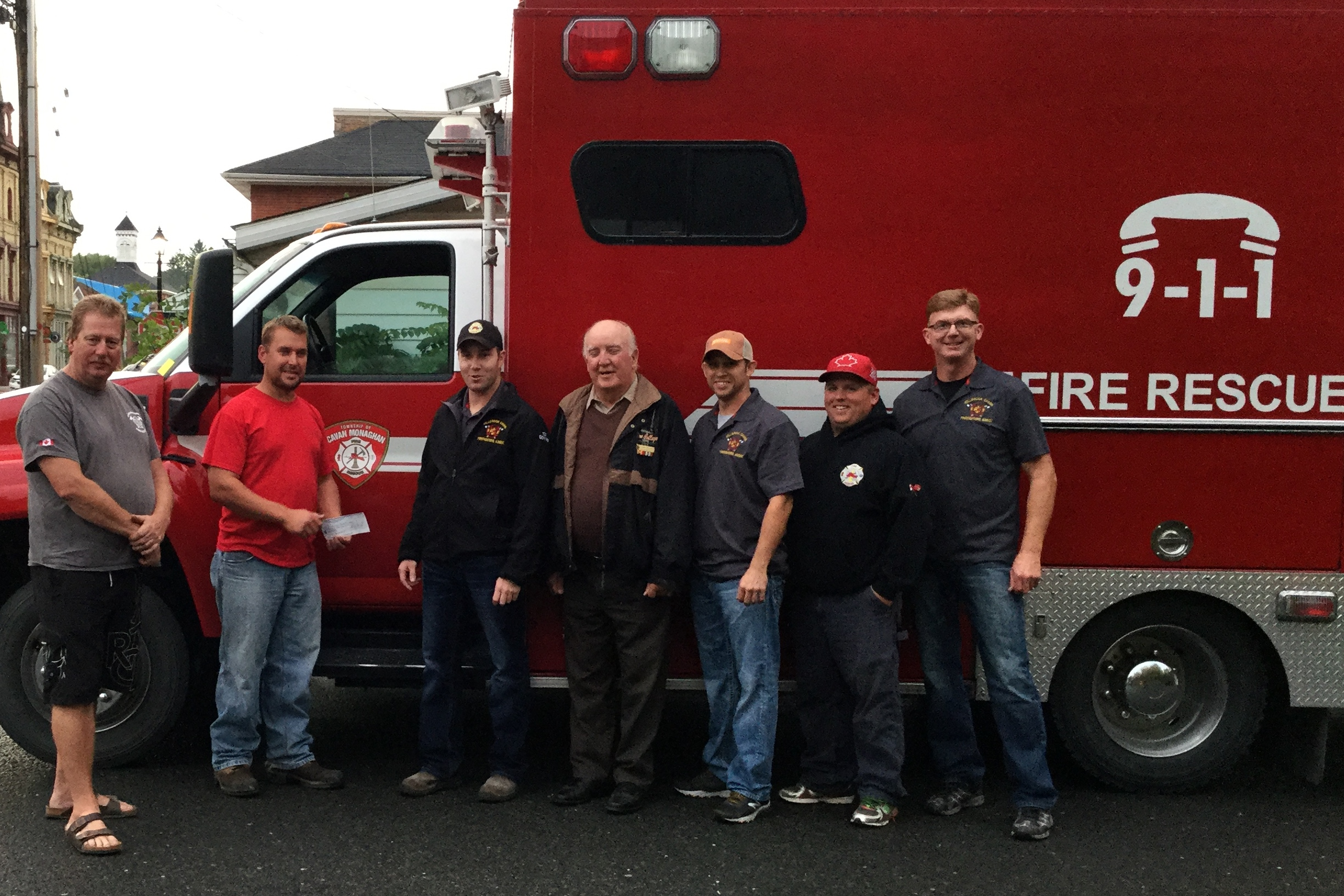 Cheque presentation of $1320 to the Millbrook Cavan Firefighters Association.  Left to right:  Firefighter Keith Shultz; Mike Telford, Cattlemen's BBQ Fundraising Chair; Adam Goyne, President of the Millbrook Cavan Firefighters Association; Larry Jinkerson, Peterborough County Cattlemen President; Steve Branscombe, Millbrook Cavan Firefighters Association Treasurer; Firefighter Matt Woodward, Firefighter Doug Wilson.