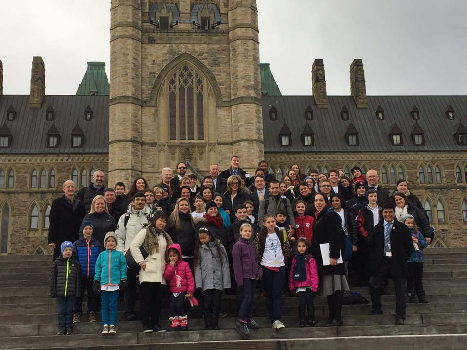 Tilly bottom row (second from left) pictured with the rest of the kids and their parents from across Canada