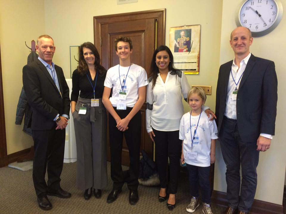 Tilly (pictured far right with her father, Matt) meeting with MPs