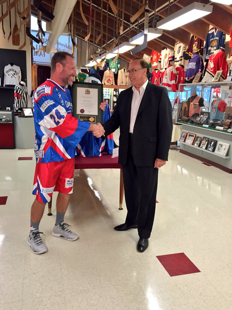 Grant Jr. being presented with a key to the city by Mayor Bennett (Photo by Scott Arnold)